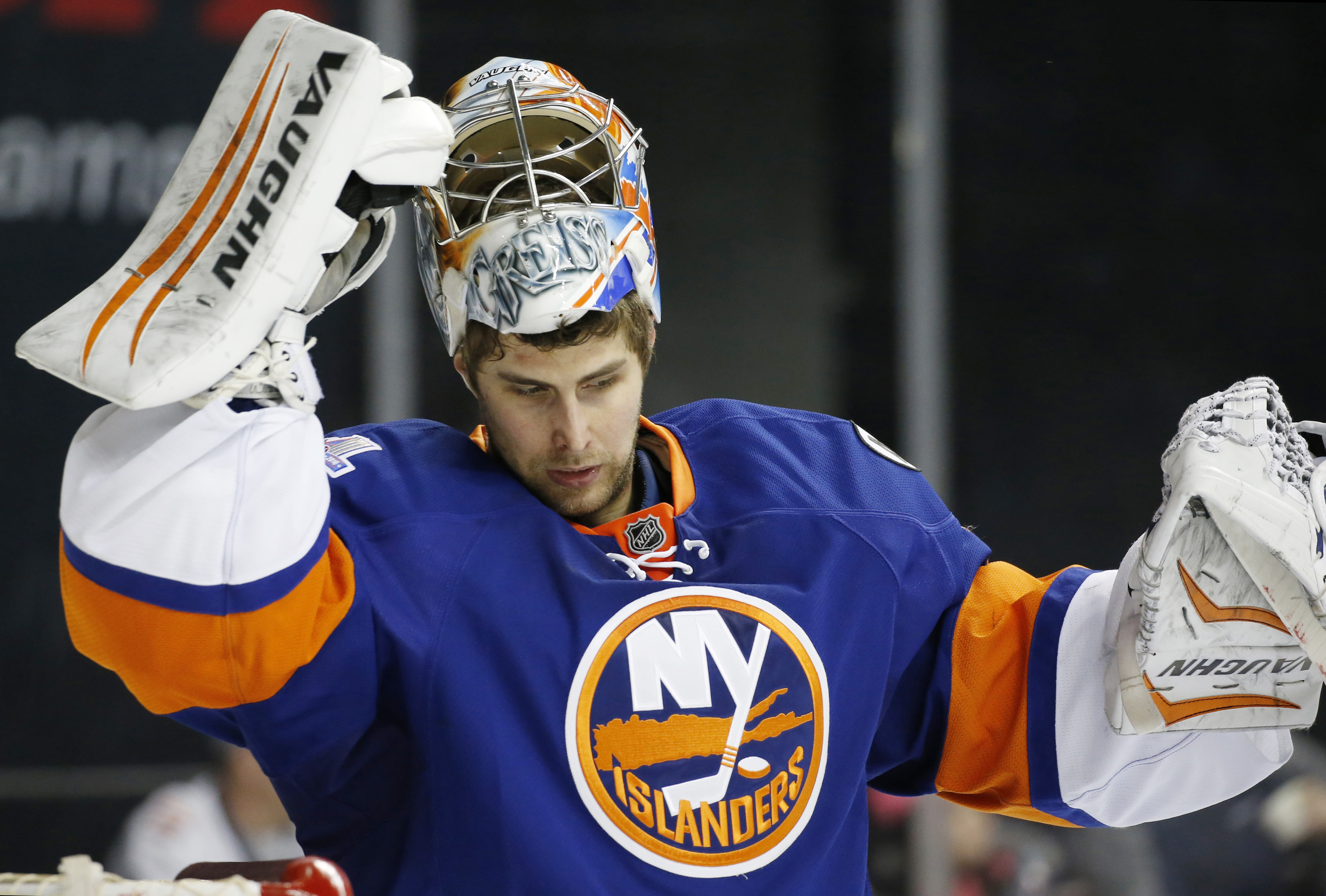 New York Islanders goalie Thomas Greiss (1) reacts after giving up a third goal to the Philadelphia Flyers in the third period of an NHL hockey game in New York, Monday, March 21, 2016. Greiss was in the net for all three periods as the Flyers defeated th