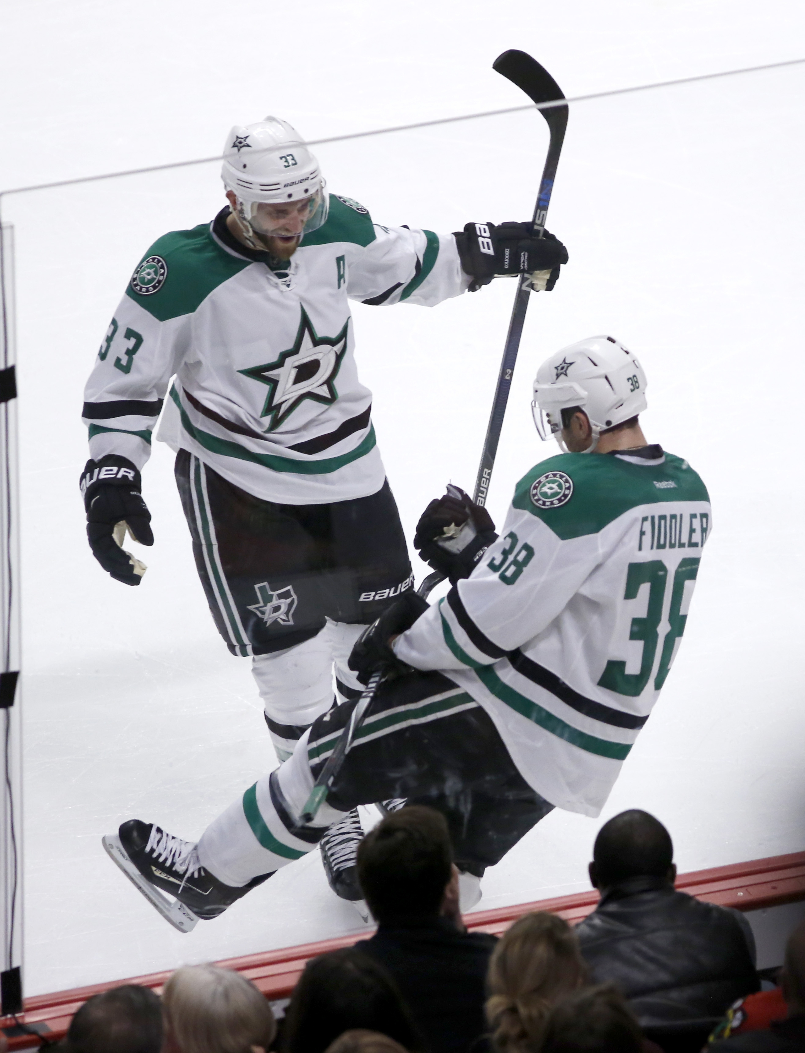 Dallas Stars' Vernon Fiddler (38) celebrates his second goal of the NHL hockey game, with Alex Goligoski during the first period against the Chicago Blackhawks on Tuesday, March 22, 2016, in Chicago. (AP Photo/Charles Rex Arbogast)