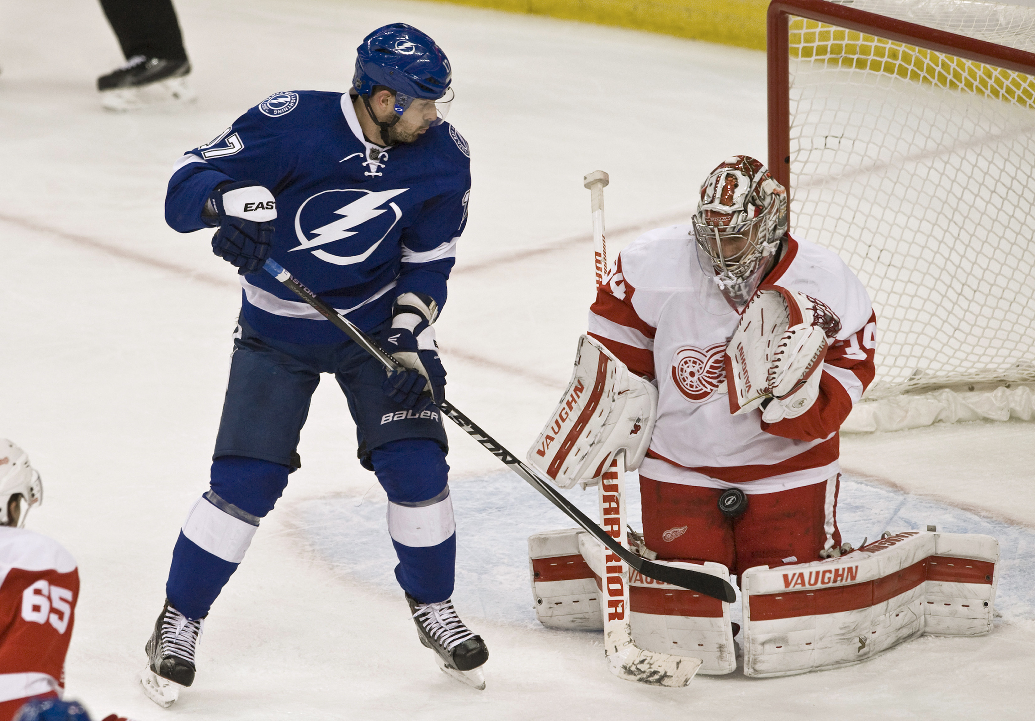 Detroit Red Wings goalie Petr Mrazek (34) stops a shot from Tampa Bay Lightning's Alex Killorn, left, during the second period of an NHL hockey game Tuesday, March 22, 2016, in Tampa, Fla. (AP Photo/Steve Nesius)