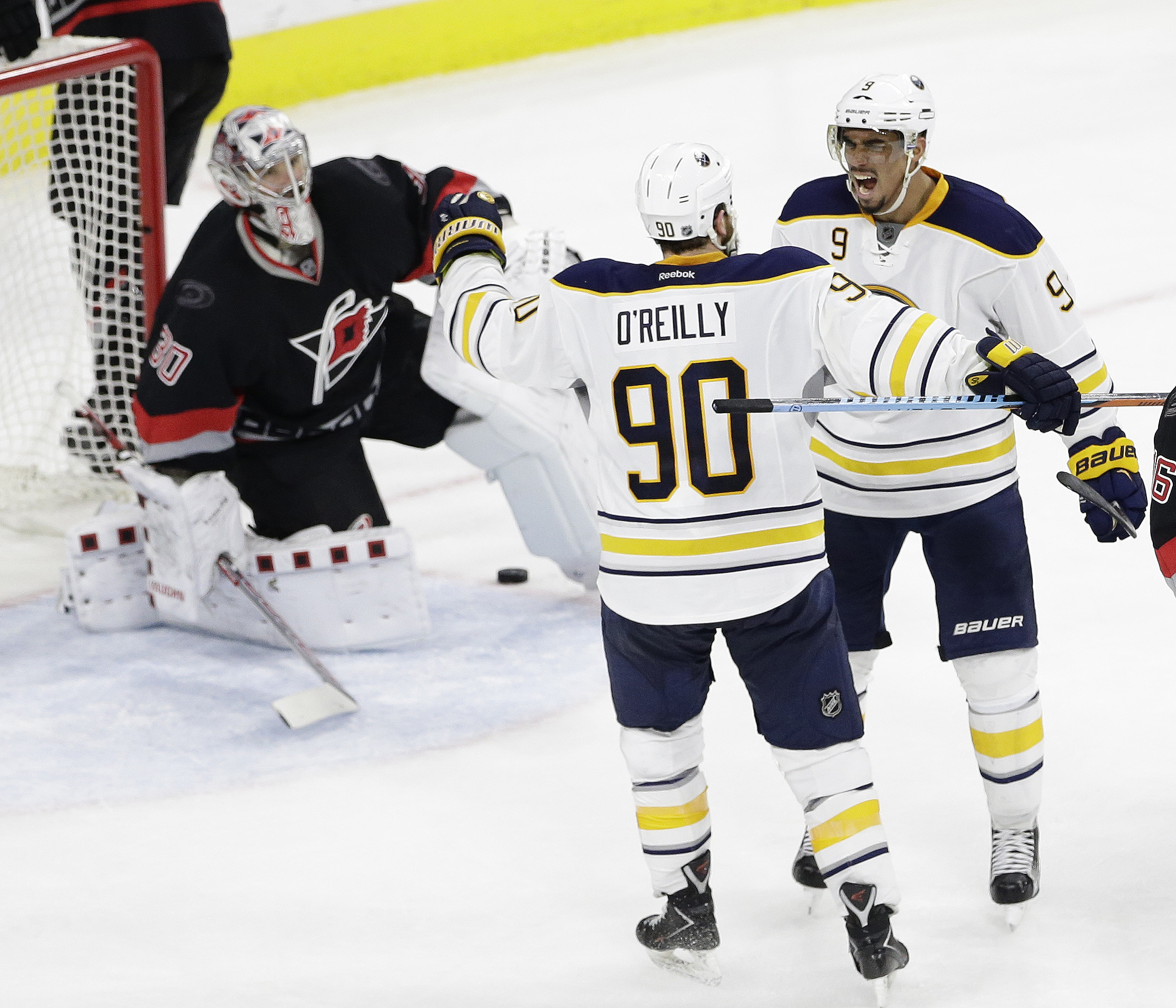 Buffalo Sabres' Ryan O'Reilly (90) congratulates Evander Kane (9) following Kane's goal against the Carolina Hurricanes during the third period of an NHL hockey game in Raleigh, N.C., Tuesday, March 22, 2016. Buffalo won 3-2. Carolina Hurricanes goalie Ca