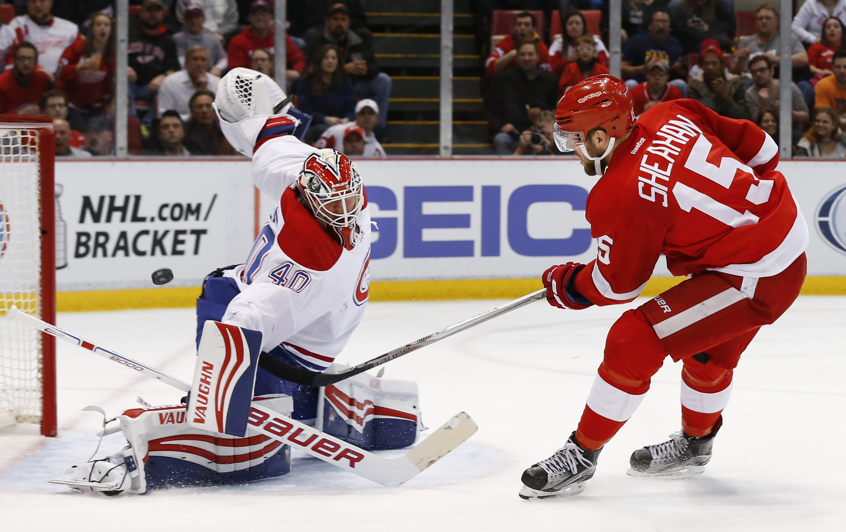 Detroit Red Wings center Riley Sheahan (15) scores on Montreal Canadiens goalie Ben Scrivens (40) in the second period of an NHL hockey game, Thursday, March 24, 2016 in Detroit. (AP Photo/Paul Sancya)