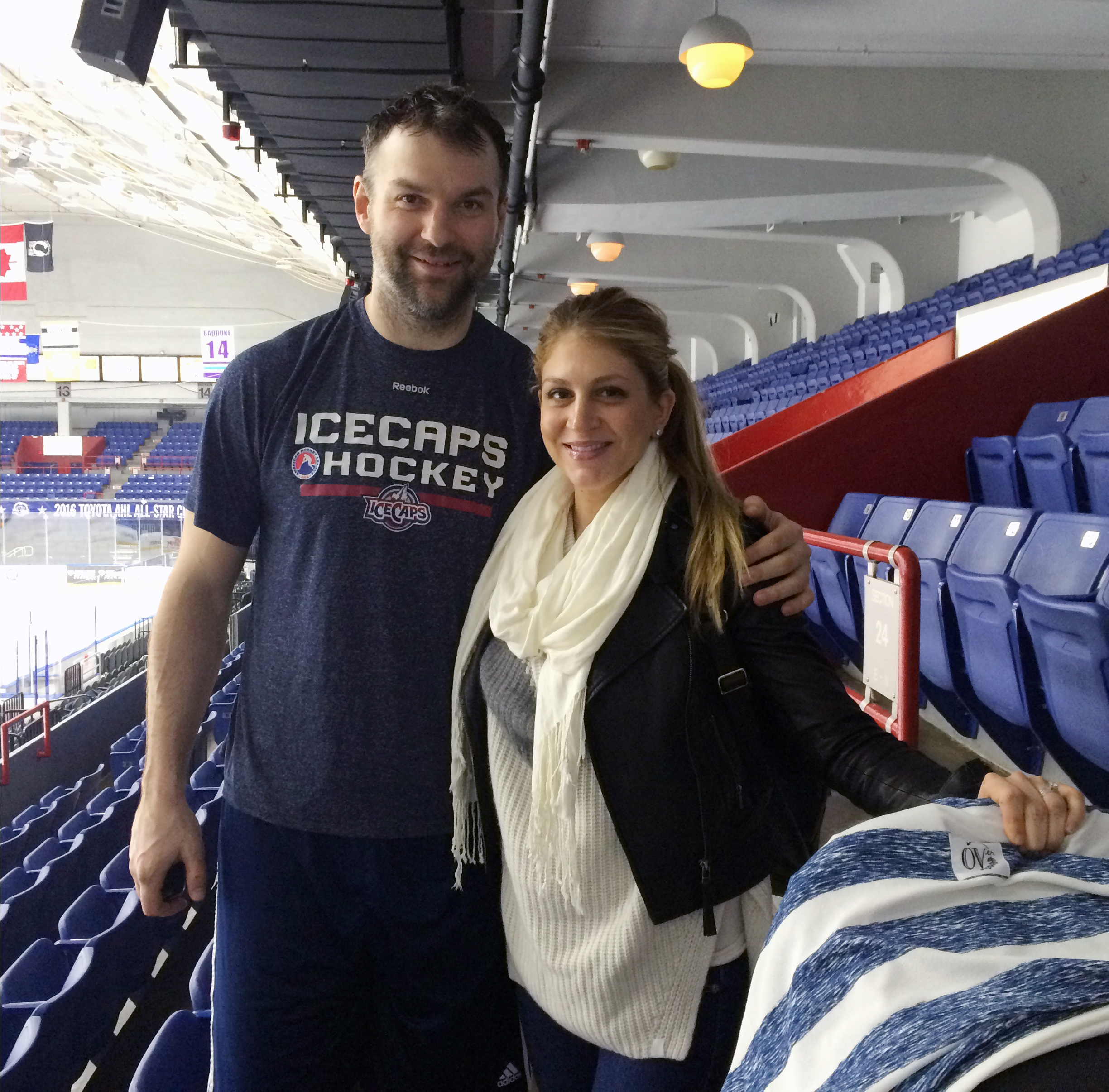 In this Sunday, March 20, 2016 photo, St. John's IceCaps hockey player John Scott and his wife, Danielle, pose after an AHL hockey match against Syracuse, in Syracuse, N.Y. The journeyman tough guy who won the hockey world over in becoming the NHL All-Sta
