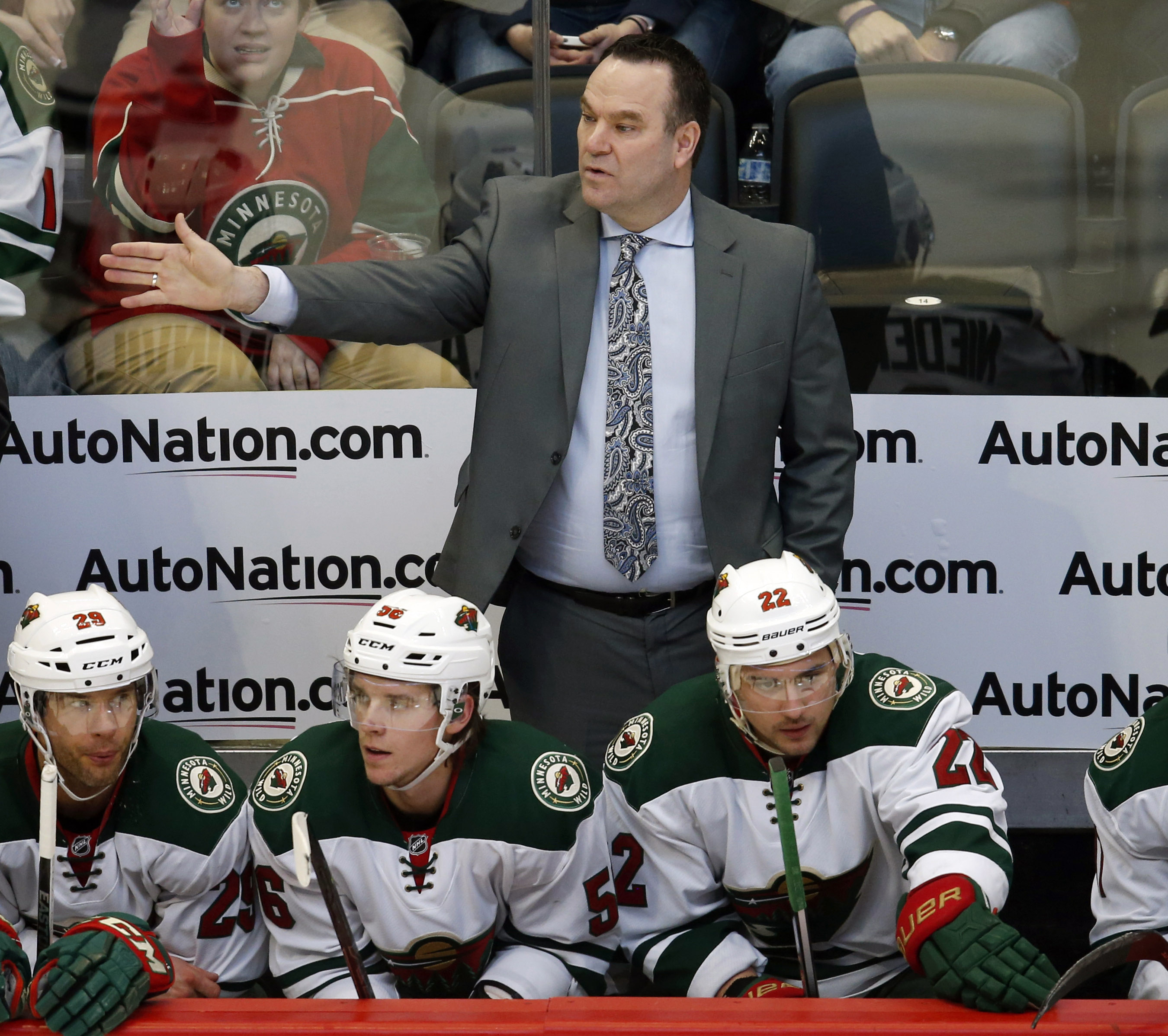 Minnesota Wild head coach John Torchetti directs his team against the Colorado Avalanche in the first period of an NHL hockey game Saturday, March 26, 2016, in Denver. (AP Photo/David Zalubowski)