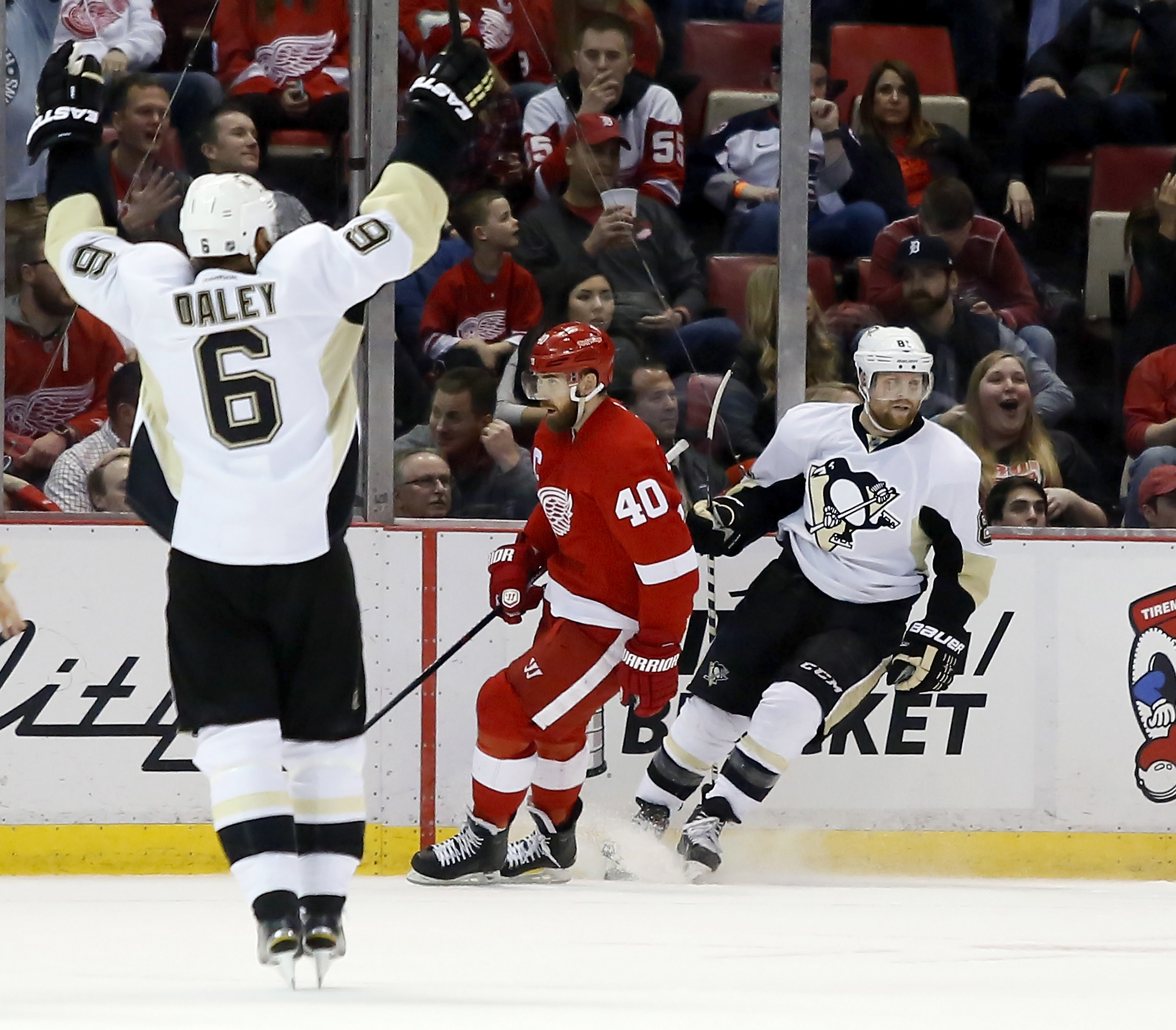 Pittsburgh Penguins' Trevor Daley (6) celebrates a goal by teammate Phil Kessel, right, as Detroit Red Wings' Henrik Zetterberg (40), of Sweden, skates away during the second period of an NHL hockey game Saturday, March 26, 2016, in Detroit. (AP Photo/Dua