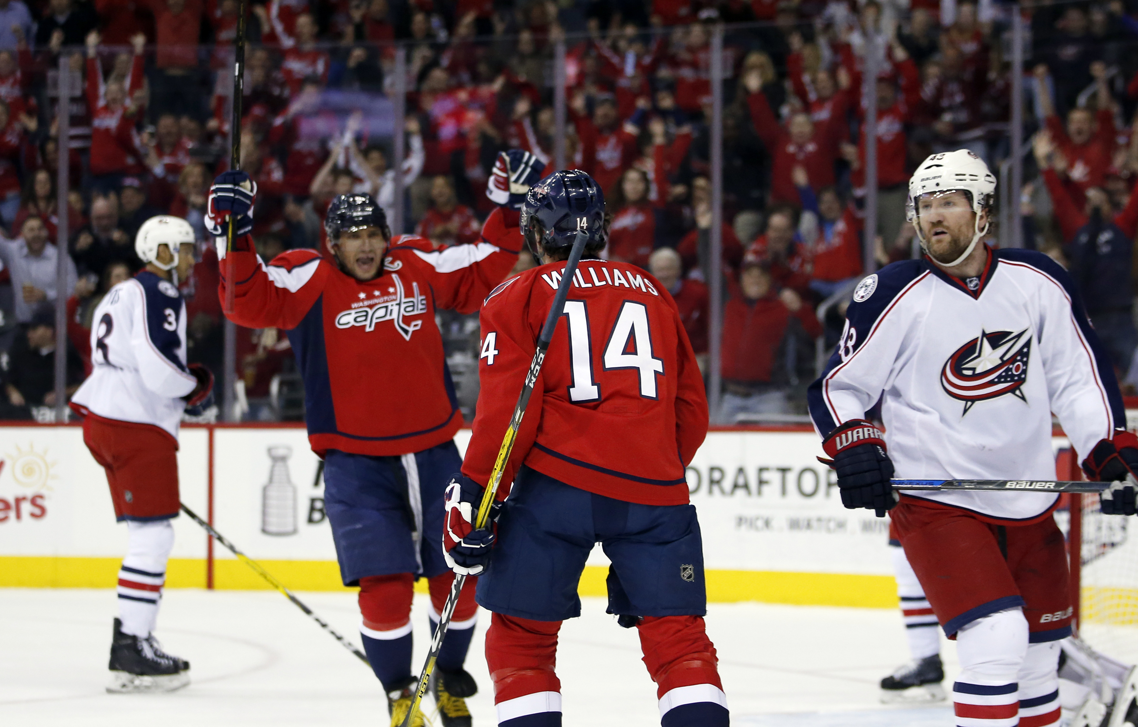 Washington Capitals left wing Alex Ovechkin (8), from Russia, and right wing Justin Williams (14) celebrate Williams' goal in the first period of an NHL hockey game against the Columbus Blue Jackets, Monday, March 28, 2016, in Washington. (AP Photo/Alex B