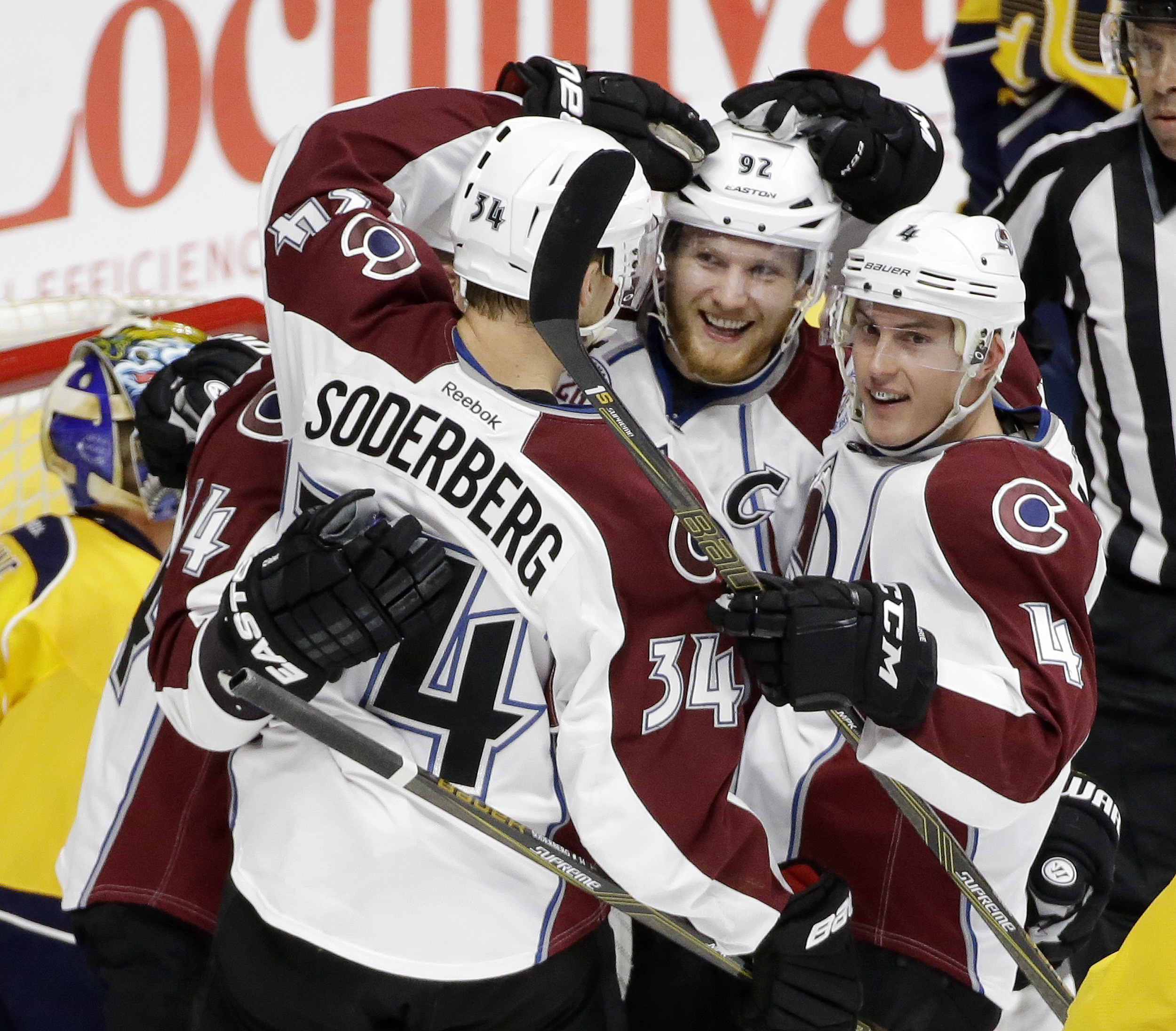 Colorado Avalanche left wing Gabriel Landeskog (92), of Sweden, is congratulated by Carl Soderberg (34), of Sweden, and Tyson Barrie (4) after Landeskog scored a goal against the Nashville Predators in the first period of an NHL hockey game Monday, March