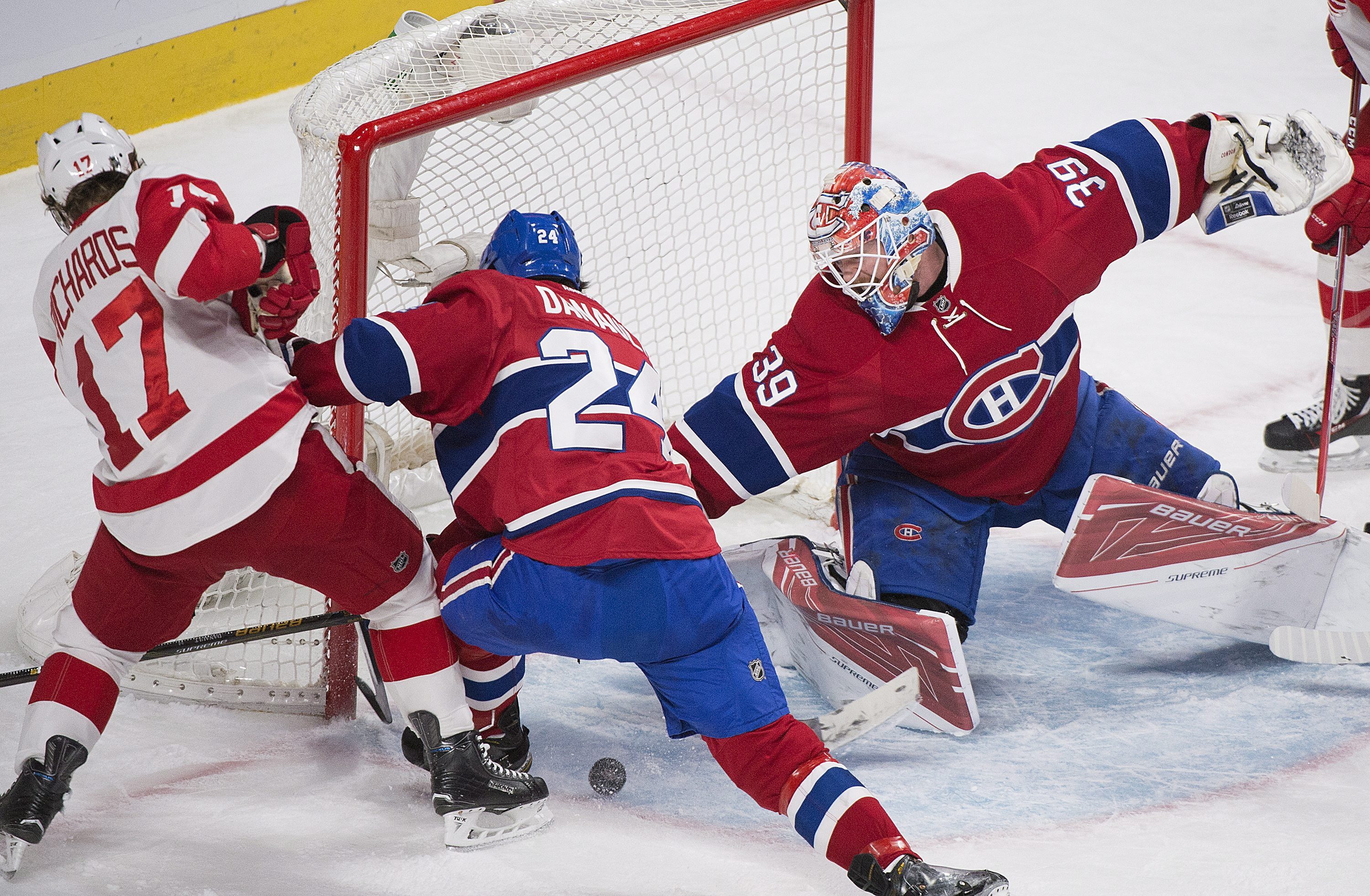 Montreal Canadiens goaltender Mike Condon makes a save against Detroit Red Wings' Brad Richards as Canadiens' Phillip Danault defends during the second period of an NHL hockey game, Tuesday, March 29, 2016 in Montreal. (Graham Hughes/The Canadian Press vi
