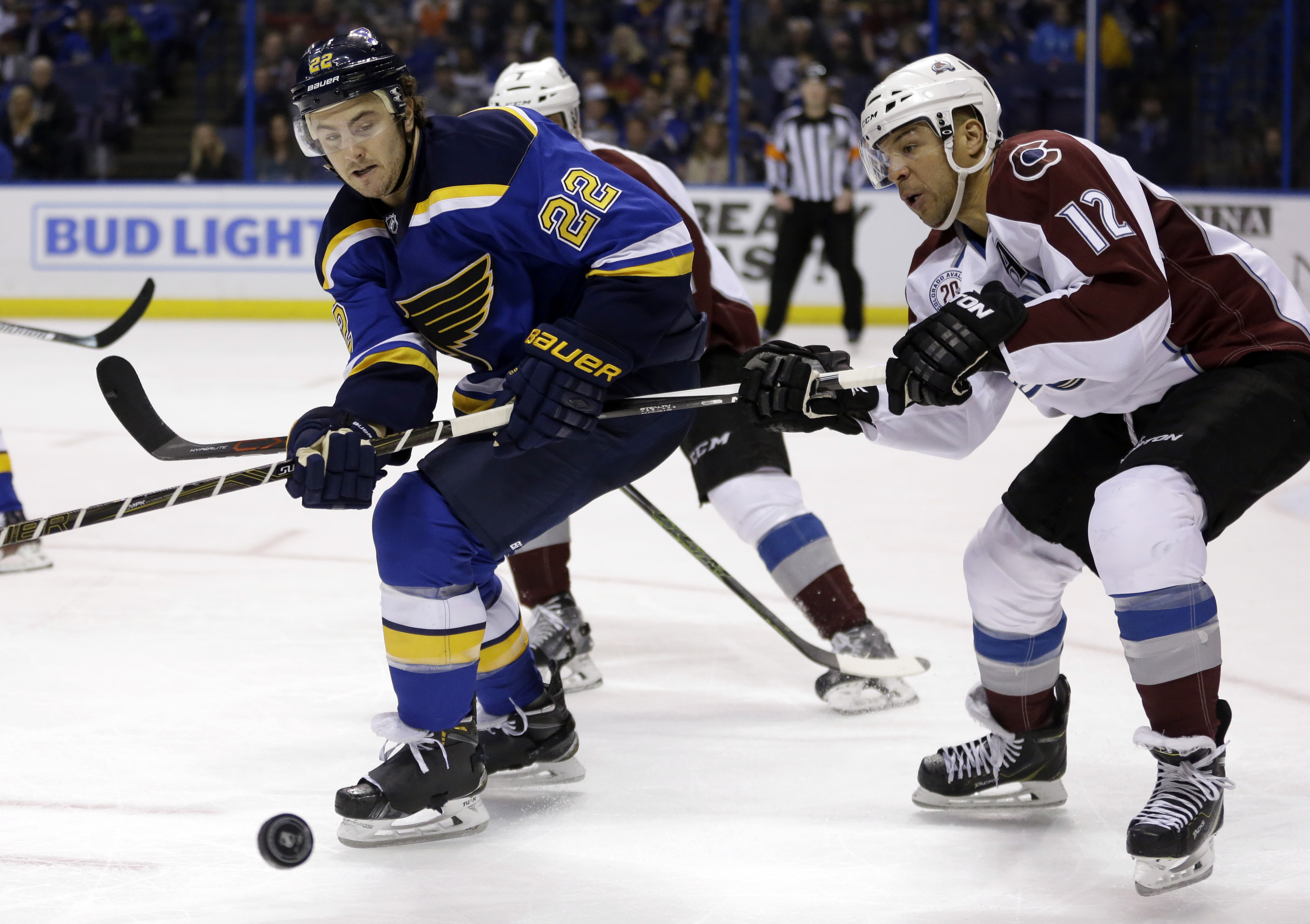 St. Louis Blues' Kevin Shattenkirk, left, watches the puck as Colorado Avalanche's Jarome Iginla defends during the third period of an NHL hockey game Tuesday, March 29, 2016, in St. Louis. The Blues won 3-1. (AP Photo/Jeff Roberson)