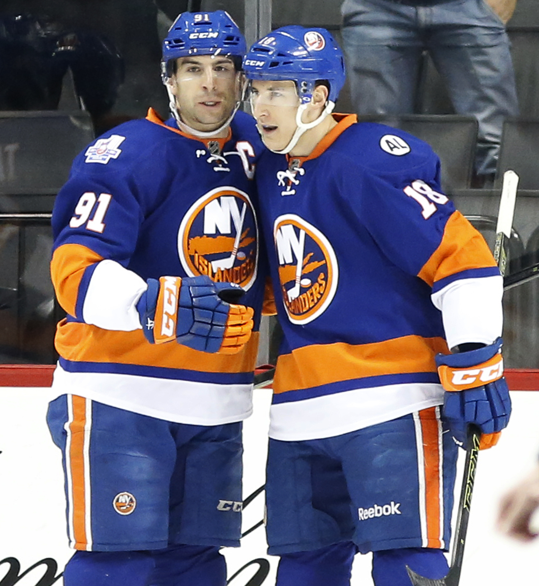 New York Islanders center John Tavares (91) and center Ryan Strome (18) celebrate Tavares' second goal in the first period of an NHL hockey game against the Columbus Blue Jackets in New York, Thursday, March 31, 2016. (AP Photo/Kathy Willens)