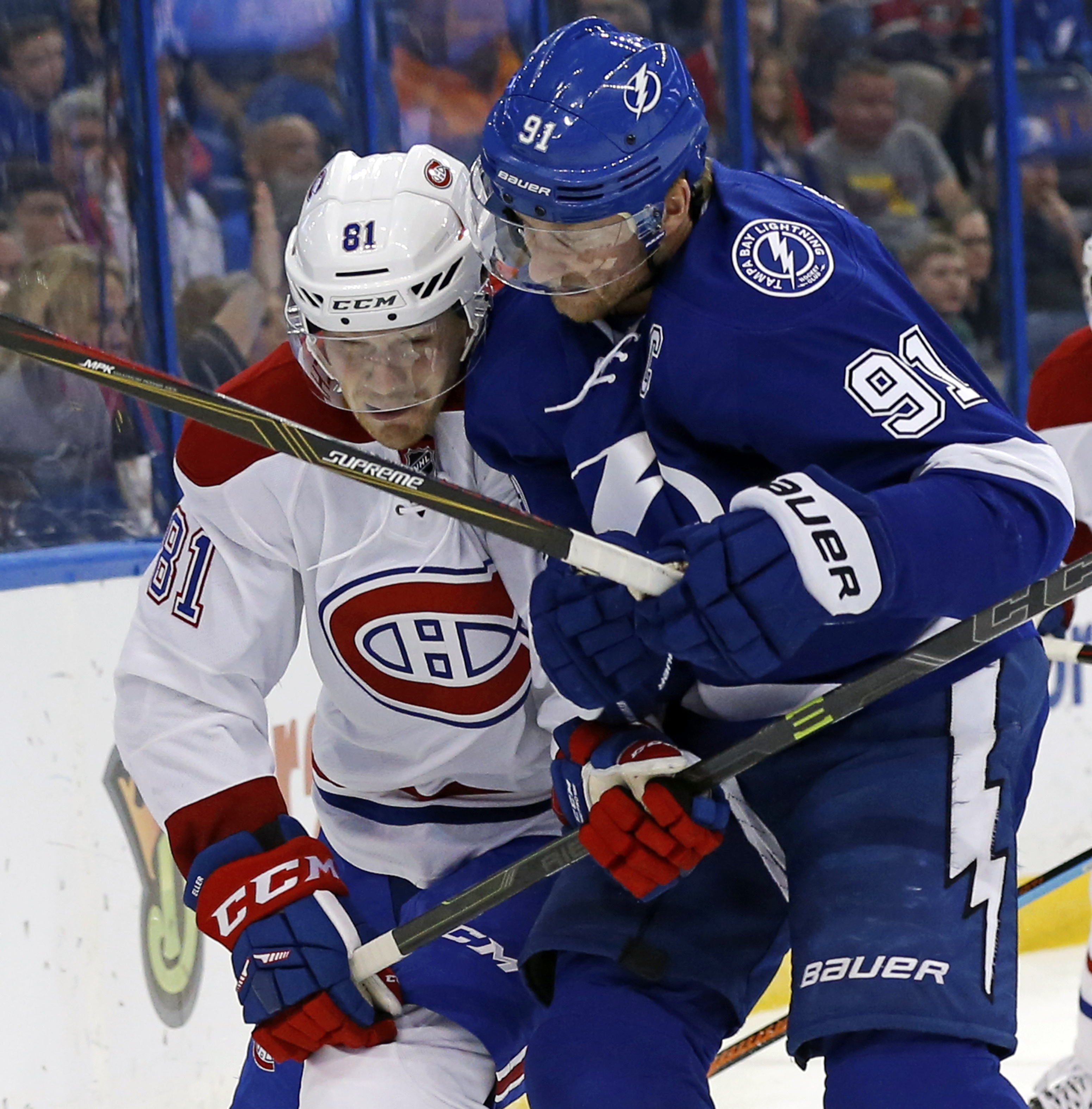 Tampa Bay Lightning's Steven Stamkos (91) checks Montreal Canadiens' Lars Eller, of Denmark,during the first period of an NHL hockey game Thursday, March 31, 2016, in Tampa, Fla. (AP Photo/Mike Carlson)