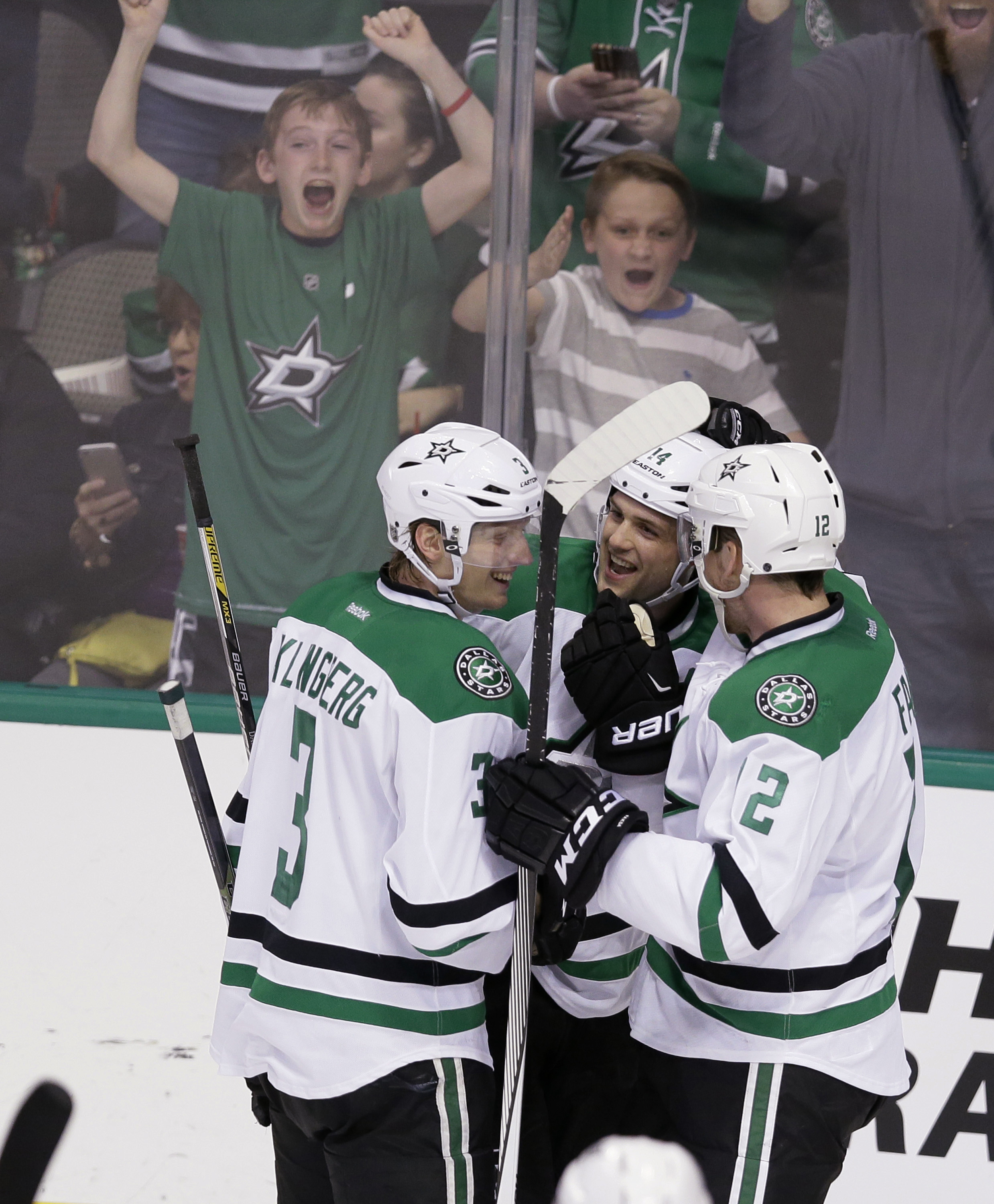 Dallas Stars left wing Jamie Benn, center celebrates scoring a goal with teammates John Klingberg (3) and Kris Russell (2) during the second period of an NHL hockey game against the Arizona Coyotes on Thursday, March 31, 2016, in Dallas. (AP Photo/LM Oter
