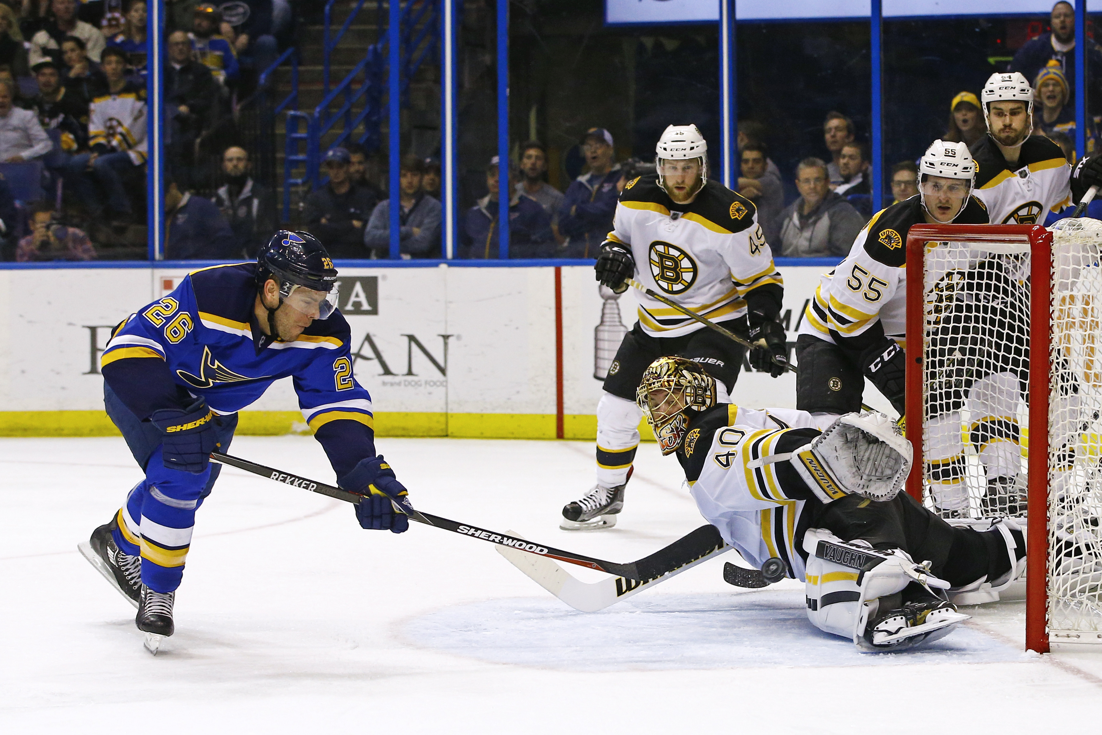 St. Louis Blues Paul Stastny, left, scores a goal past the outstretched glove of Boston Bruins goalie Tuukka Rask, of Finland, during the second period of an NHL hockey game Friday, April 1, 2016, in St. Louis. (AP Photo/Billy Hurst)