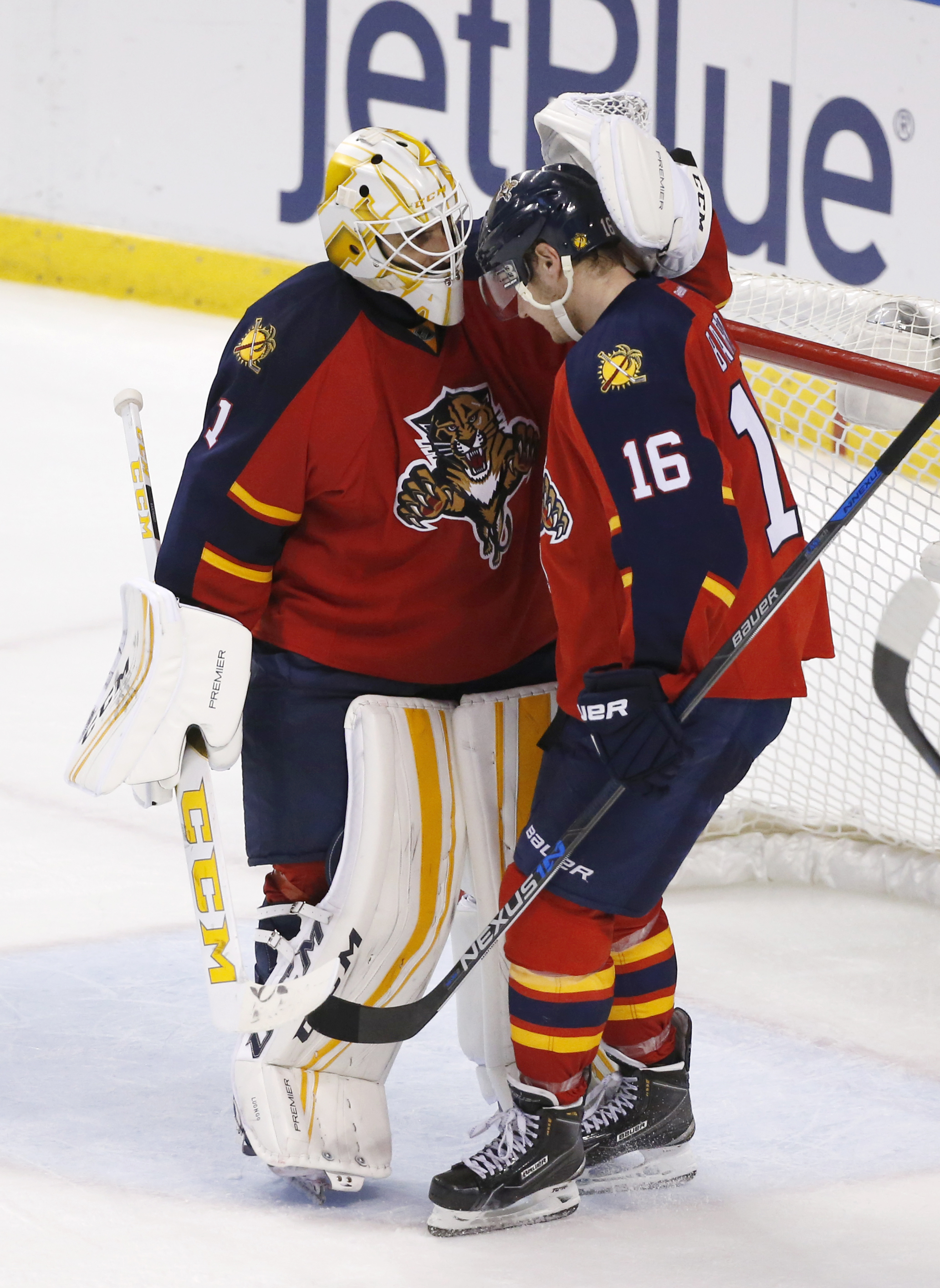 Florida Panthers goalie Roberto Luongo (1) and center Aleksander Barkov (16) celebrate after they defeated the Montreal Canadiens in an NHL hockey game, Saturday, April 2, 2016, in Sunrise, Fla. (AP Photo/Wilfredo Lee)