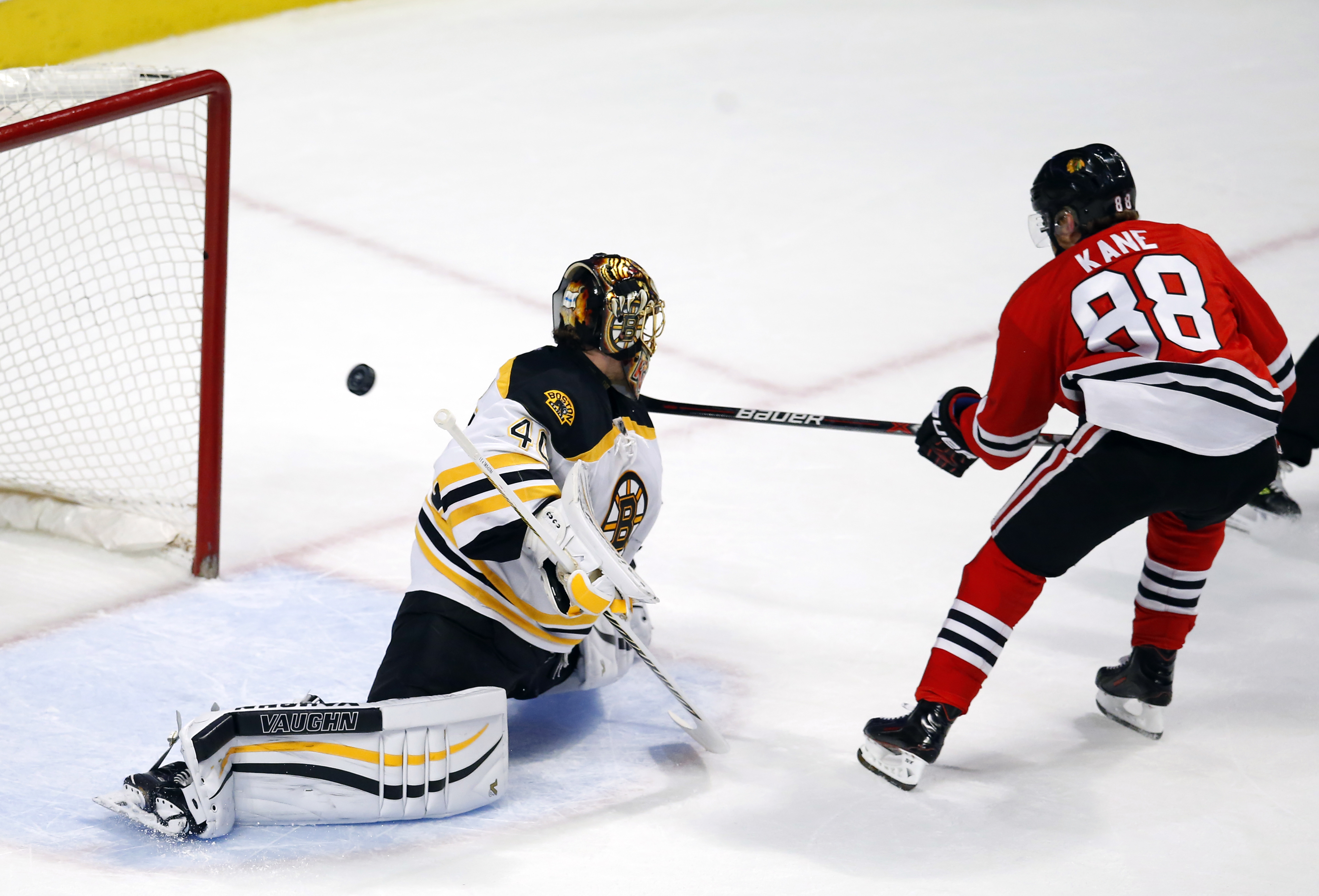 Chicago Blackhawks right wing Patrick Kane (88) scores a goal past Boston Bruins goalie Tuukka Rask (40) during the first period of an NHL hockey game Sunday, April 3, 2016, in Chicago. (AP Photo/Jeff Haynes)