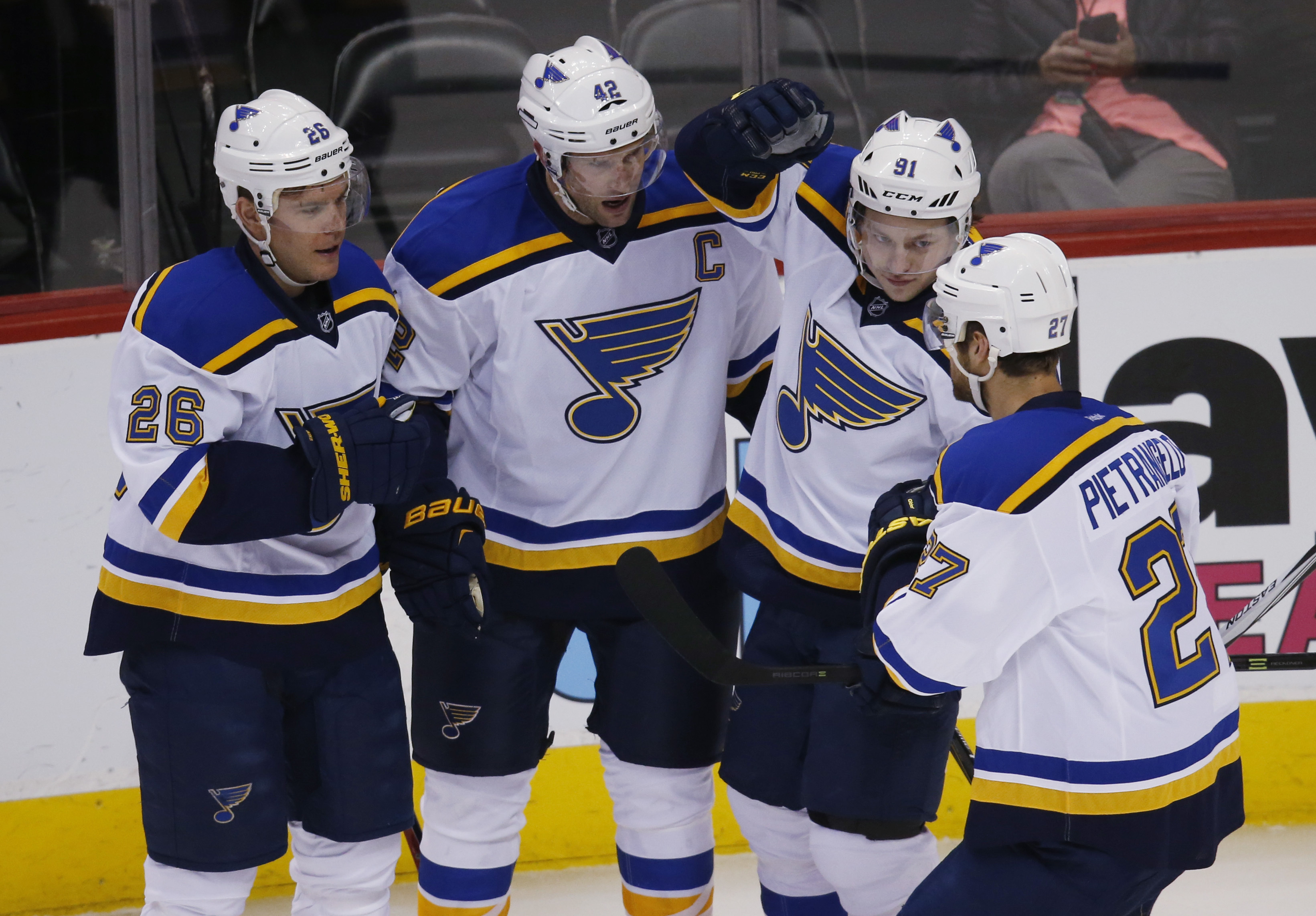 St. Louis Blues center David Backes, second from left, celebrates scoring a goal with, from left, center Paul Stastny, right wing Vladimir Tarasenko, of Russia, and defenseman Alex Pietrangelo against the Colorado Avalanche in the first period of an NHL h