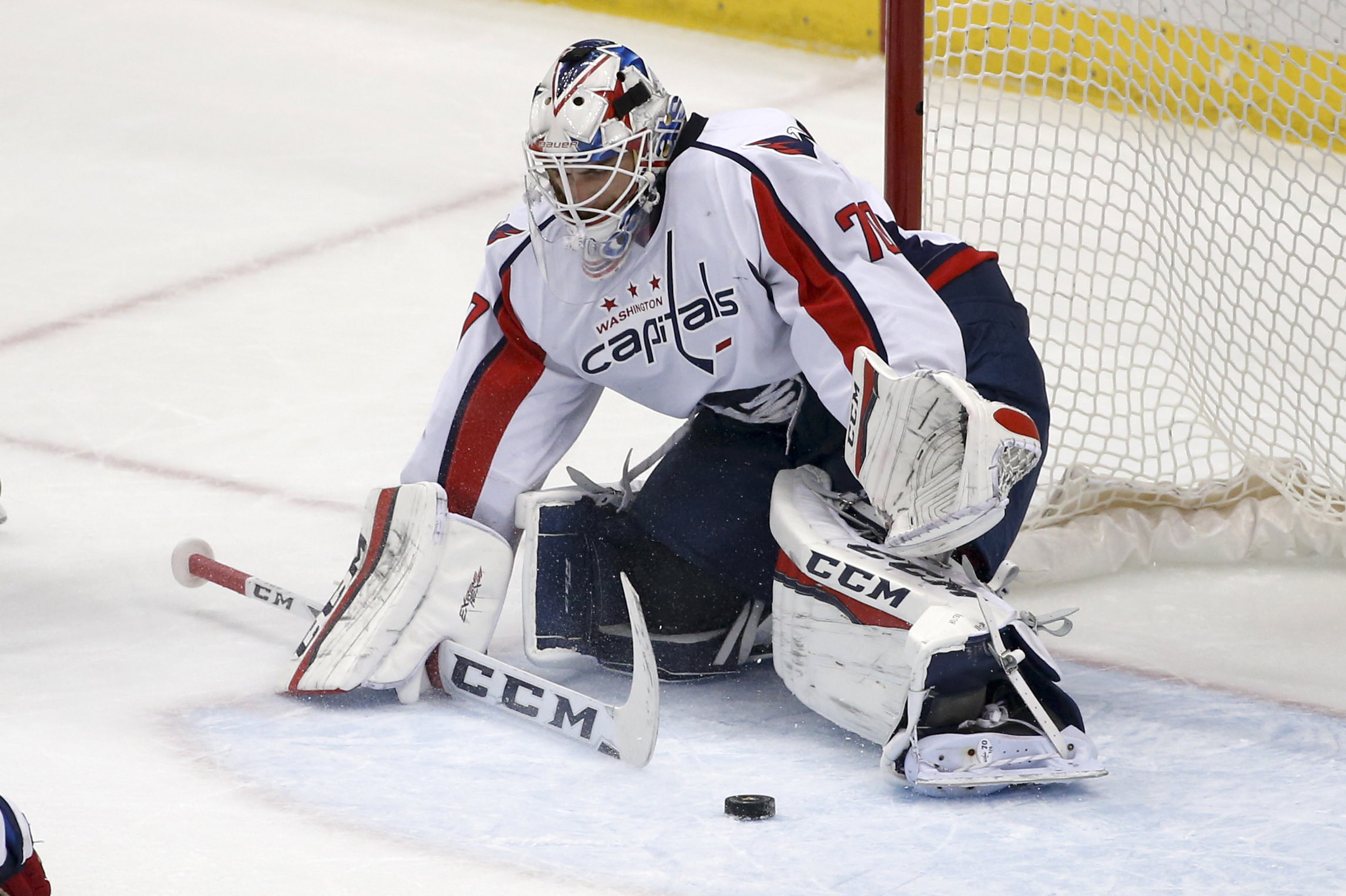 In this photo taken March 20, 2016, Washington Capitals goalie Braden Holtby (70) plays during an NHL hockey game against the Pittsburgh Penguins in Pittsburgh. Holtby is on the verge of tying Martin Brodeur's single-season record of 48 wins with time lef
