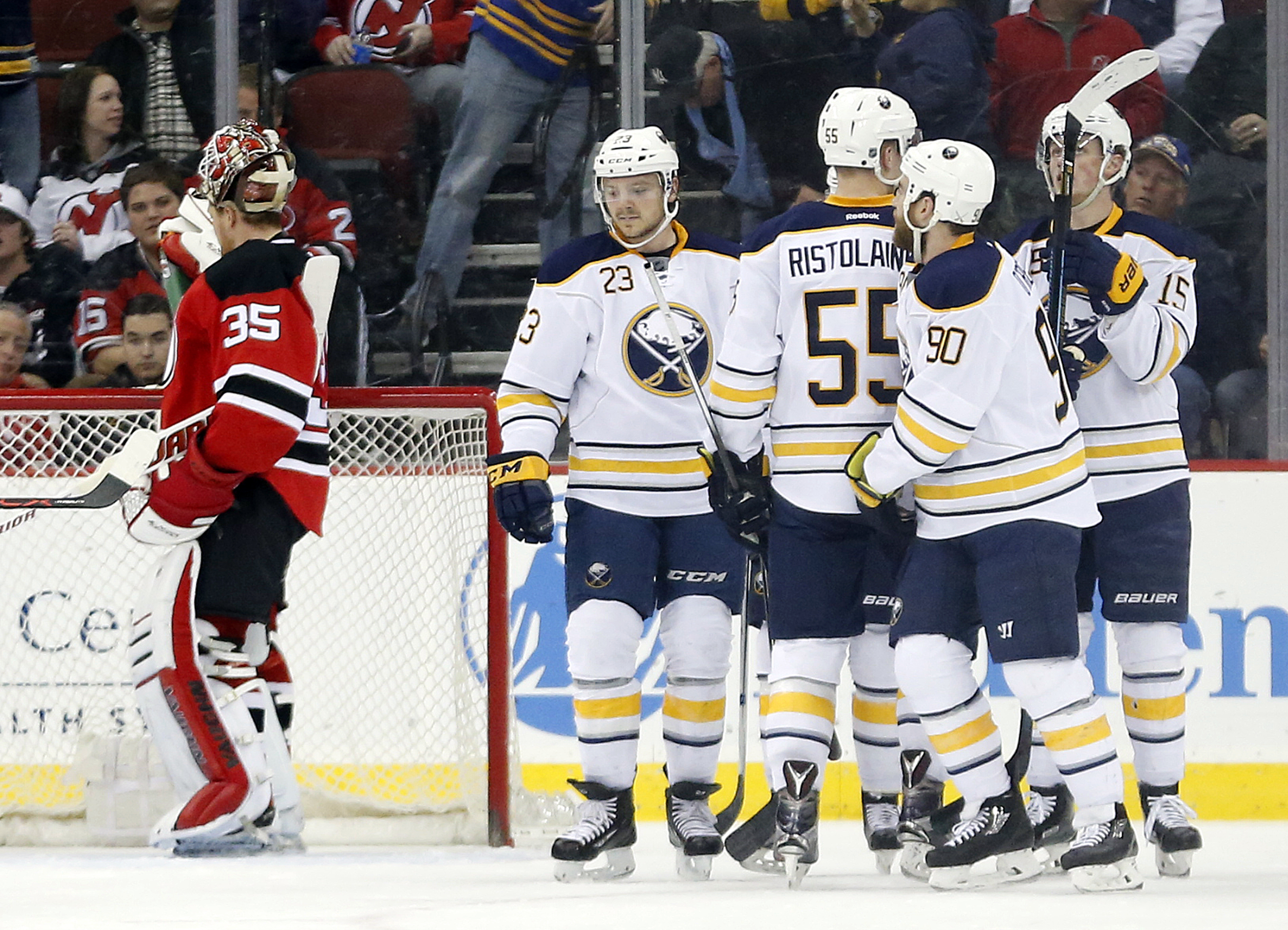 Buffalo Sabres players celebrate a goal by Ryan O'Reilly (90) against the New Jersey Devils during the second period of an NHL hockey game, Tuesday, April 5, 2016, in Newark, N.J. (AP Photo/Julio Cortez)