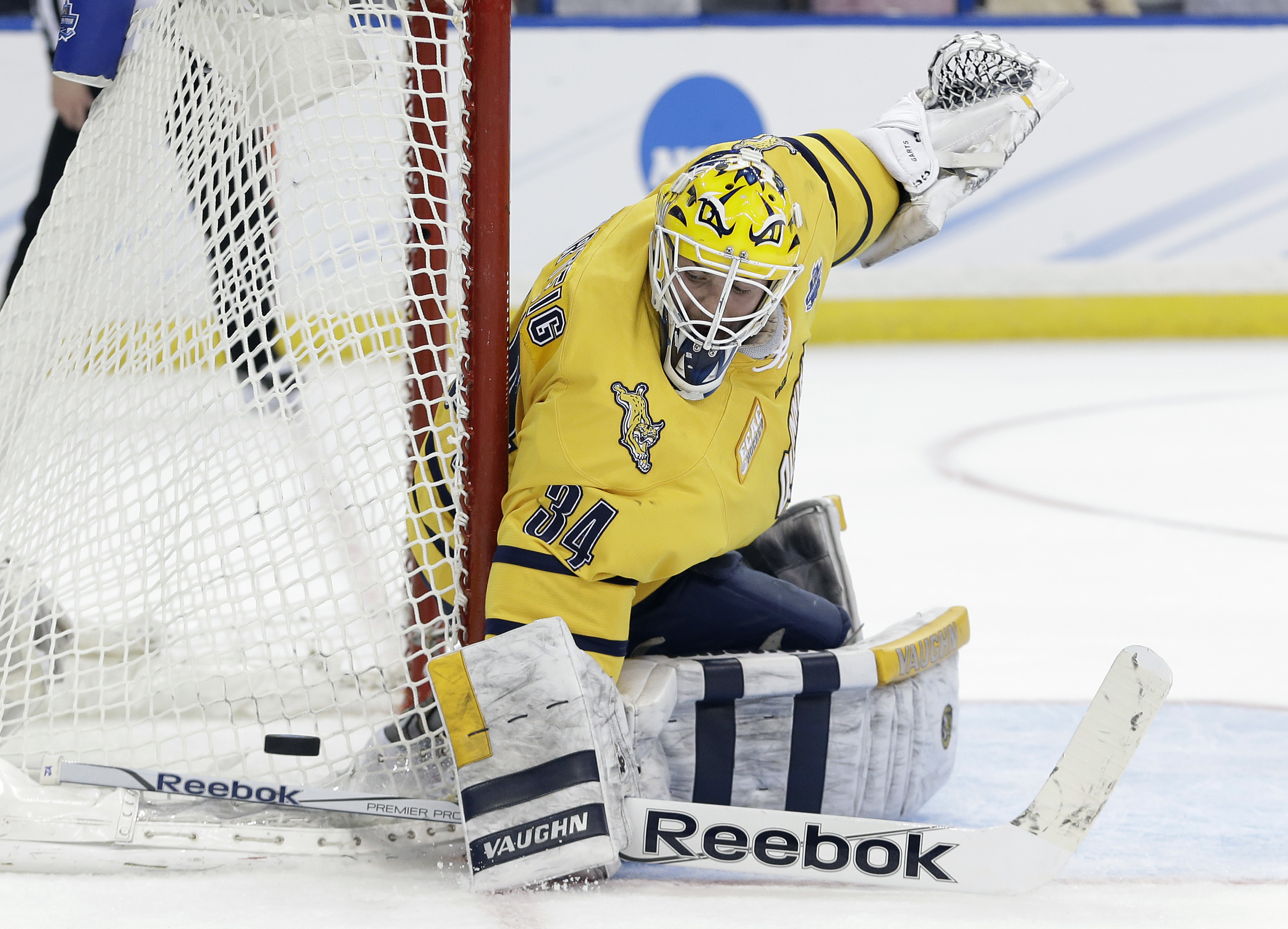 Quinnipiac goalie Michael Garteig makes a save on a shot by Boston College during the first period of an NCAA Frozen Four semifinal men's college hockey game Thursday, April 7, 2016, in Tampa, Fla. (AP Photo/Chris O'Meara)