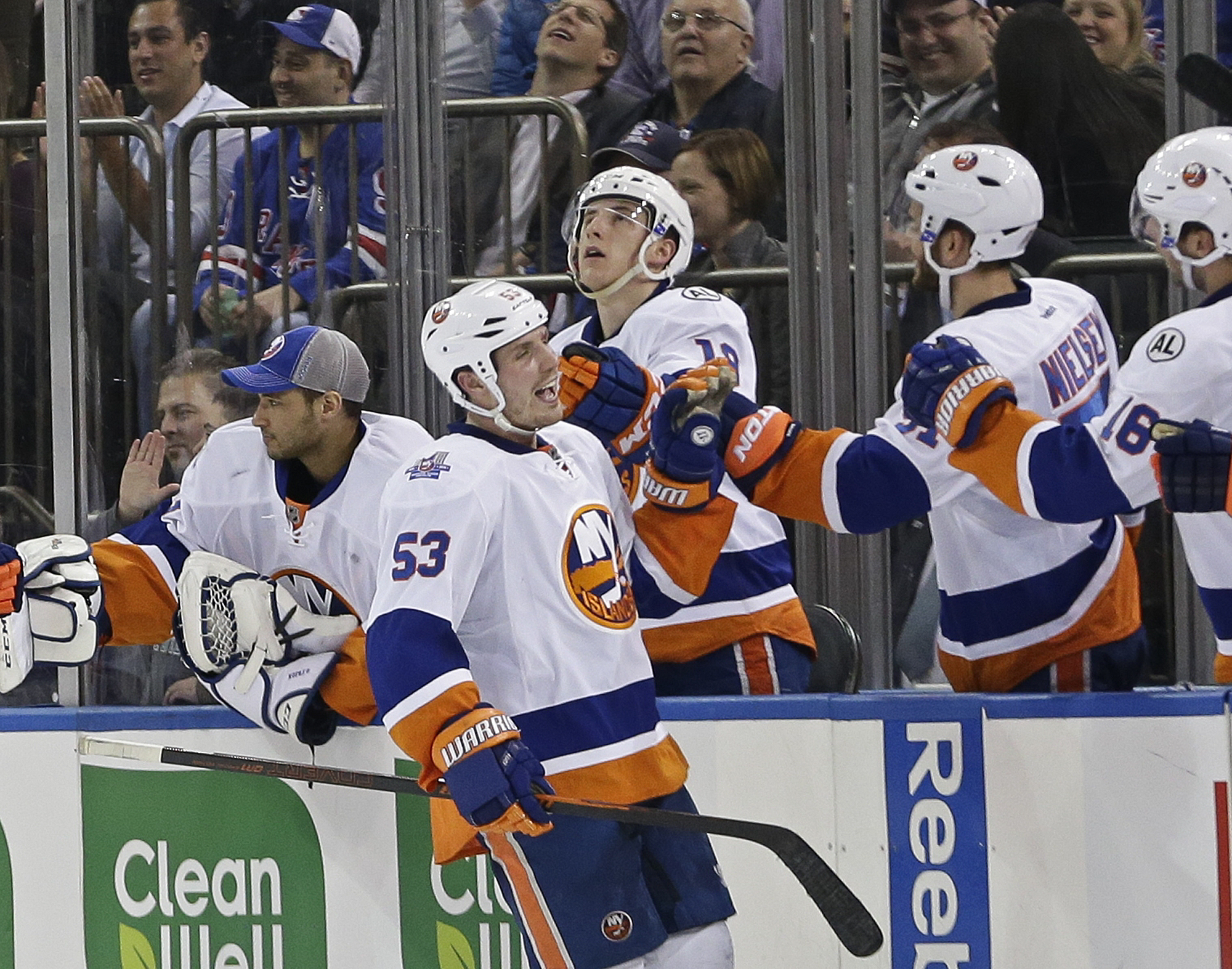 New York Islanders' Casey Cizikas (53) celebrates with teammates after scoring a goal during the second period of an NHL hockey game against the New York Rangers on Thursday, April 7, 2016, in New York. (AP Photo/Frank Franklin II)