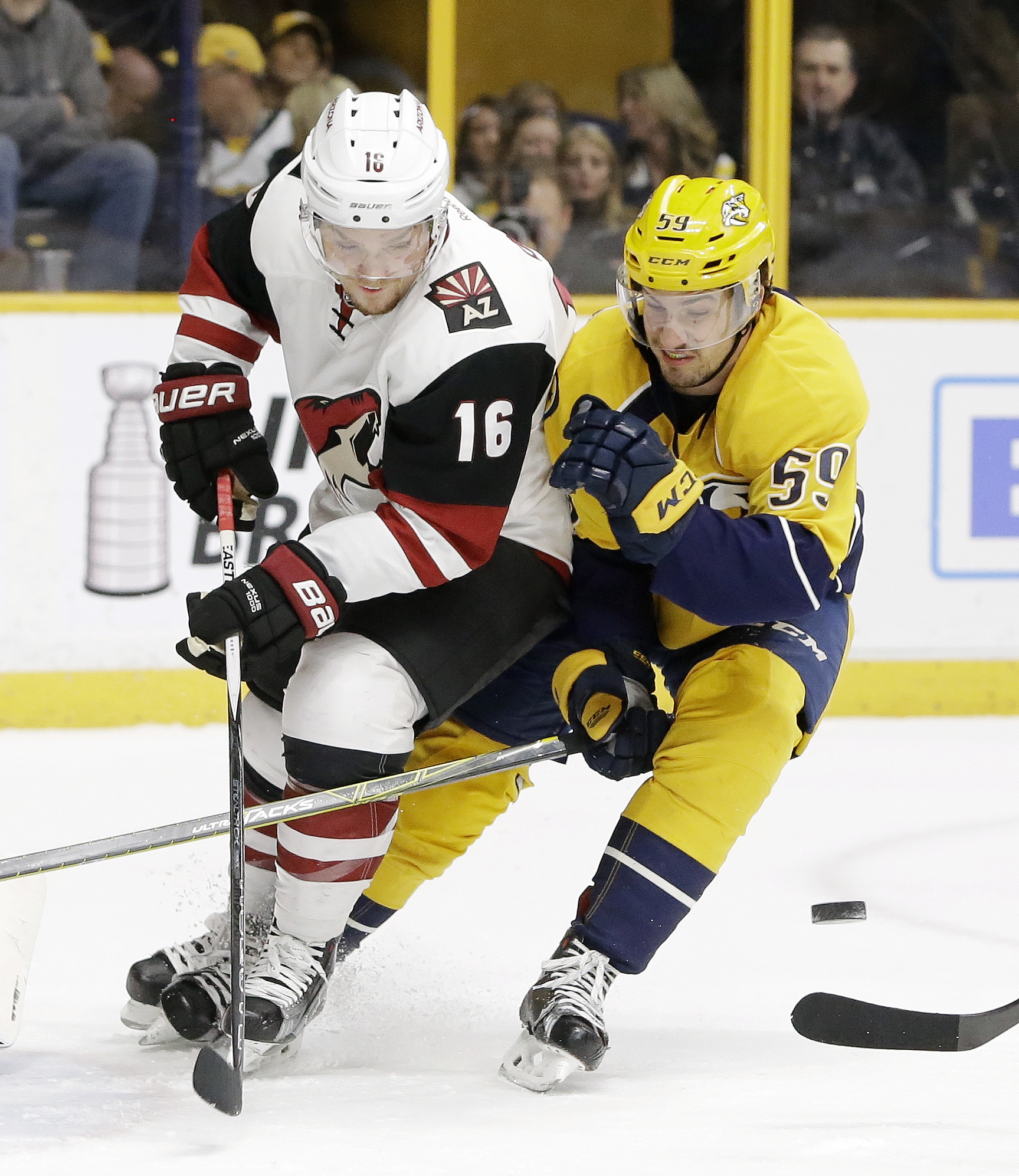 Arizona Coyotes center Max Domi (16) loses the puck as he is defended by Nashville Predators' Roman Josi (59), of Switzerland, in the first period of an NHL hockey game Thursday, April 7, 2016, in Nashville, Tenn. (AP Photo/Mark Humphrey)