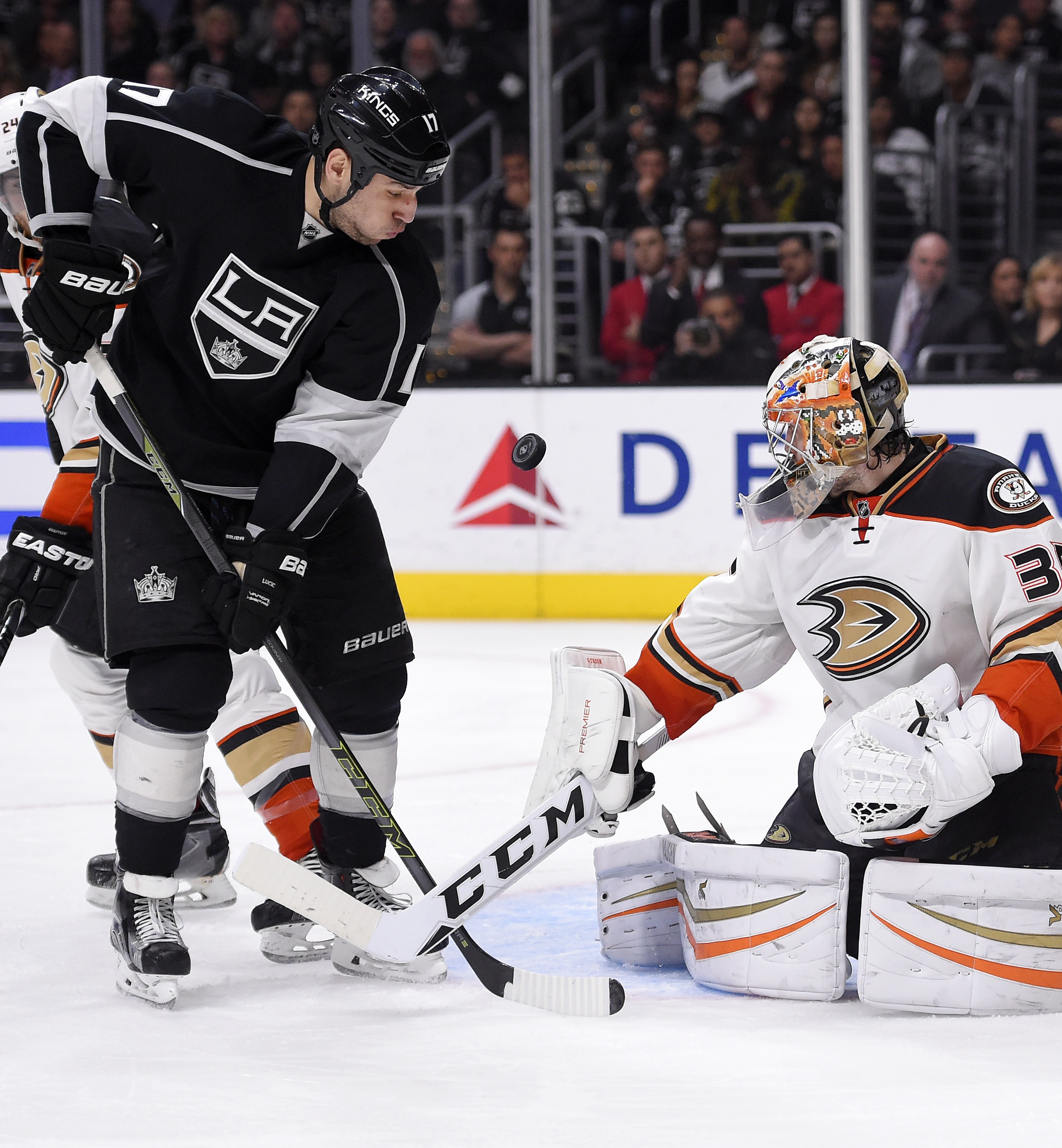 Los Angeles Kings left wing Milan Lucic, left, tries to get a shot in on Anaheim Ducks goalie John Gibson during the second period of an NHL hockey game Thursday, April 7, 2016, in Los Angeles. (AP Photo/Mark J. Terrill)
