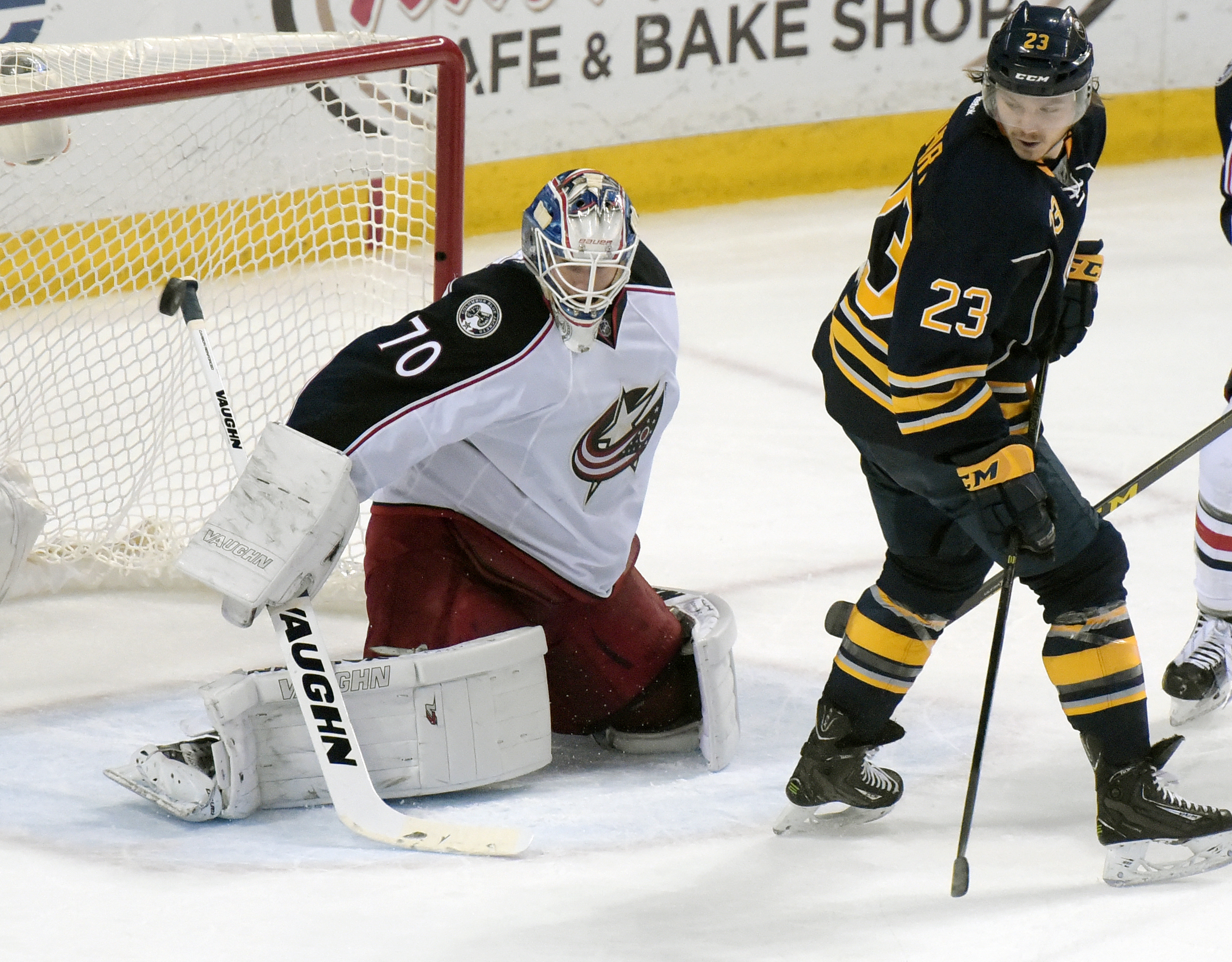 Buffalo Sabres center Sam Reinhart (23), deflects the puck past Columbus Blue Jackets goaltender Joonas Korpisalo (70), of Finland, during the second period of an NHL hockey game, Friday, April 8, 2016, in Buffalo, N.Y. (AP Photo/Gary Wiepert)