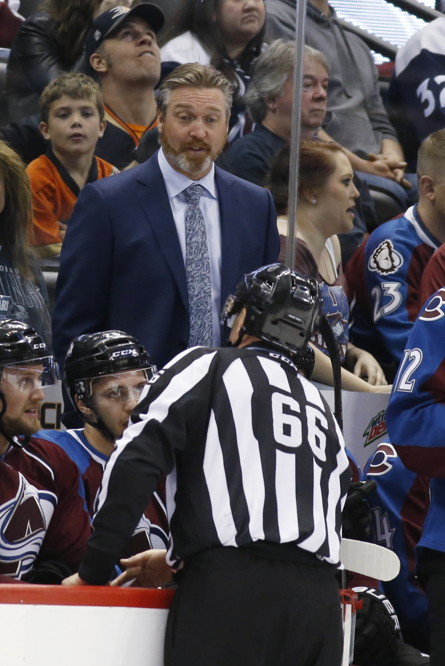 Colorado Avalanche head coach Patrick Roy, top, argues with linesman Darren Gibbs (66) while facing the Anaheim Ducks in the first period of an NHL hockey game Saturday, April 9, 2016, in Denver. (AP Photo/David Zalubowski)
