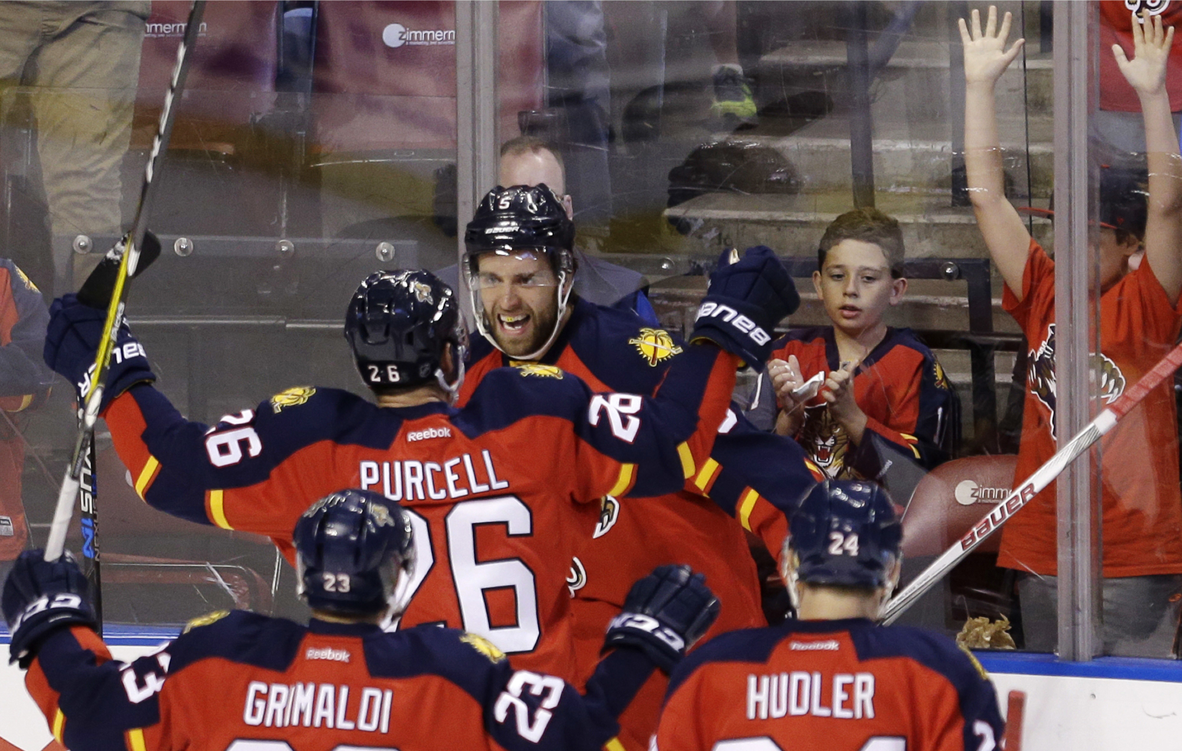 Florida Panthers defenseman Aaron Ekblad (5) is congratulated by teammates after scoring a goal against the Carolina Hurricanes during the first period of an NHL hockey game, Saturday, April 9, 2016, in Sunrise, Fla. (AP Photo/Alan Diaz)