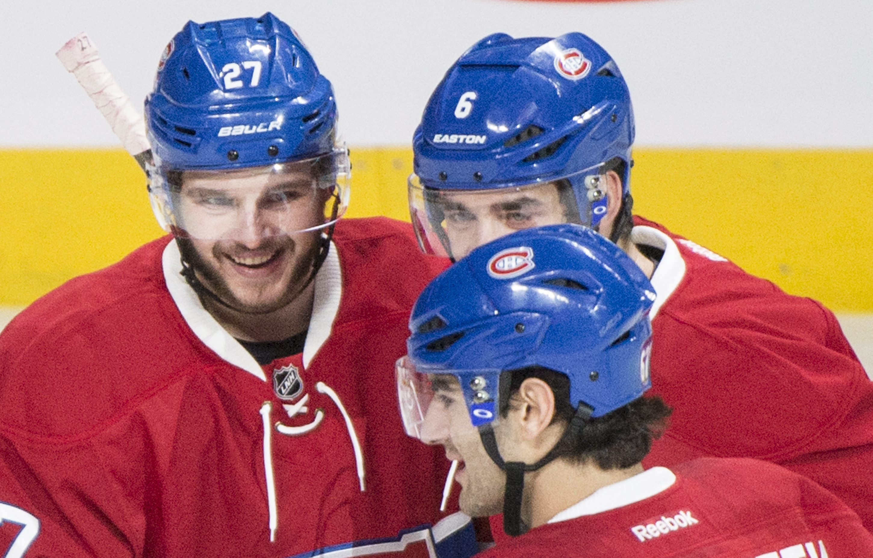 Montreal Canadiens' Alex Galchenyuk, left, celebrates with teammates Greg Pateryn (6) and Max Pacioretty (67) after scoring against the Tampa Bay Lightning during first-period NHL hockey game action in Montreal, Saturday, April 9, 2016. (Graham Hughes/The