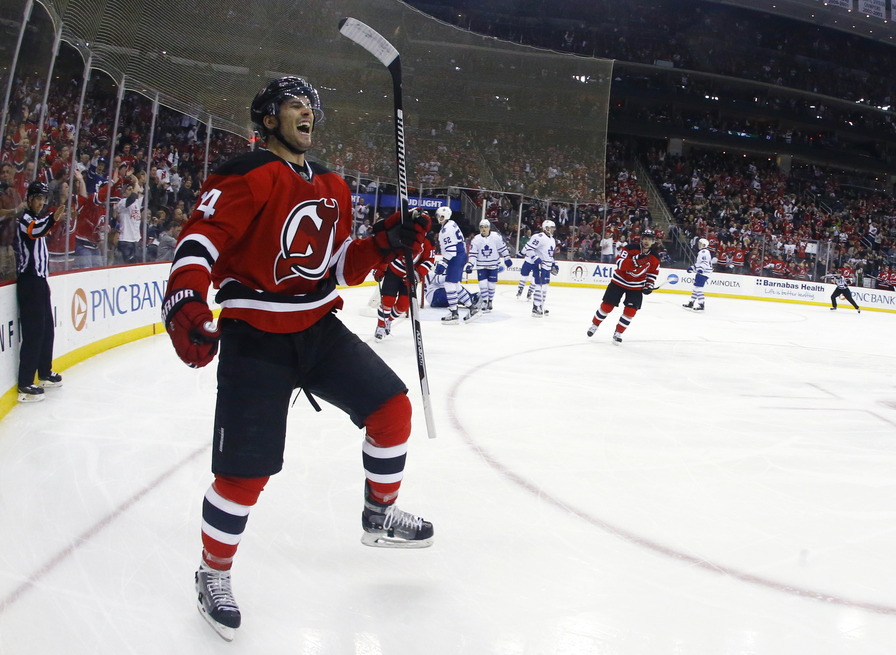 New Jersey Devils center Adam Henrique reacts after scoring a goal against the Toronto Maple Leafs during the second period of an NHL hockey game, Saturday, April 9, 2016, in Newark, N.J. (AP Photo/Julio Cortez)