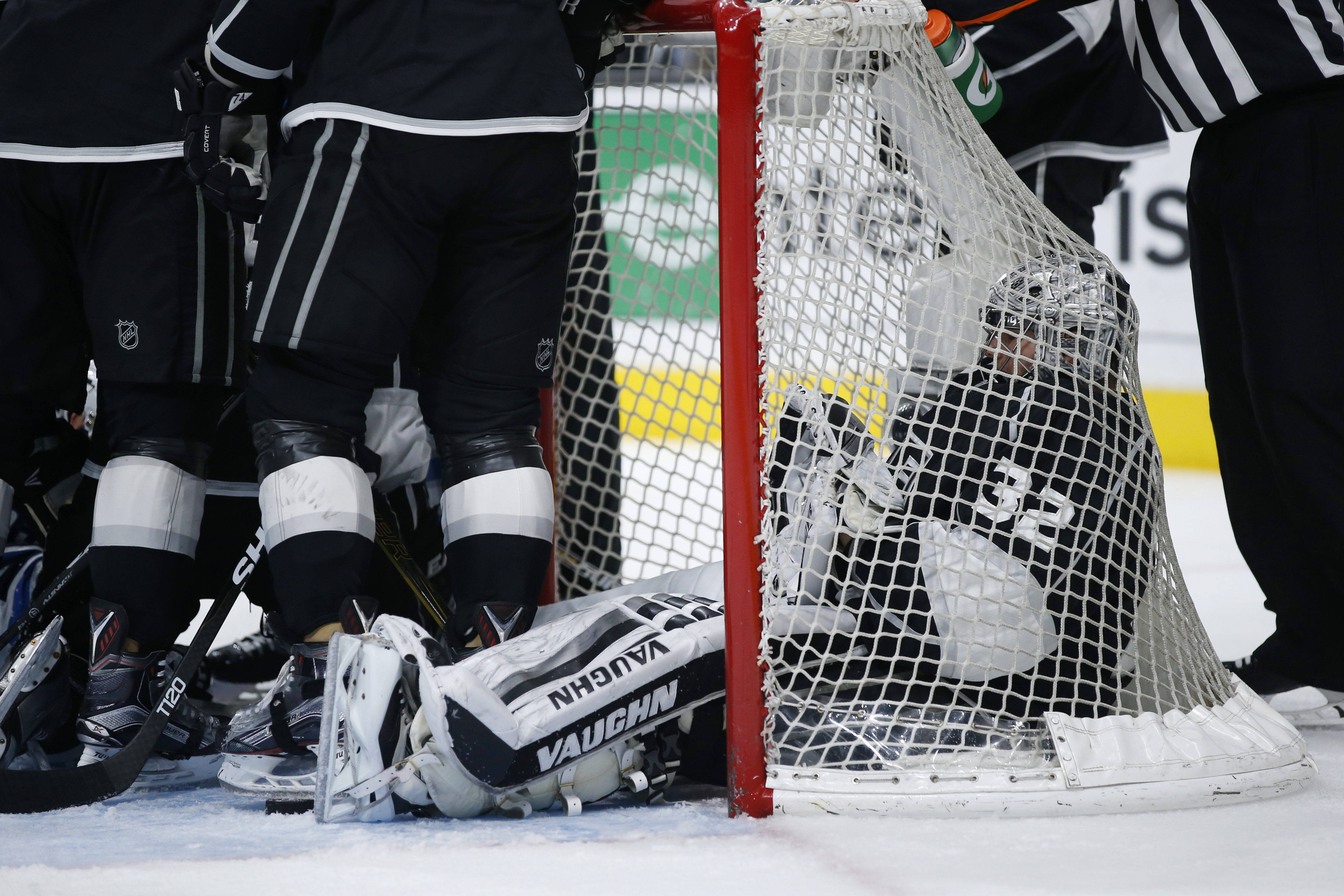Los Angeles Kings goalie Jonathan Quick sits in the net as he waits for the crease to clear of players following a whistle, after making a save against the Winnipeg Jets during the third period of an NHL hockey game, Saturday, April 9, 2016, in Los Angele