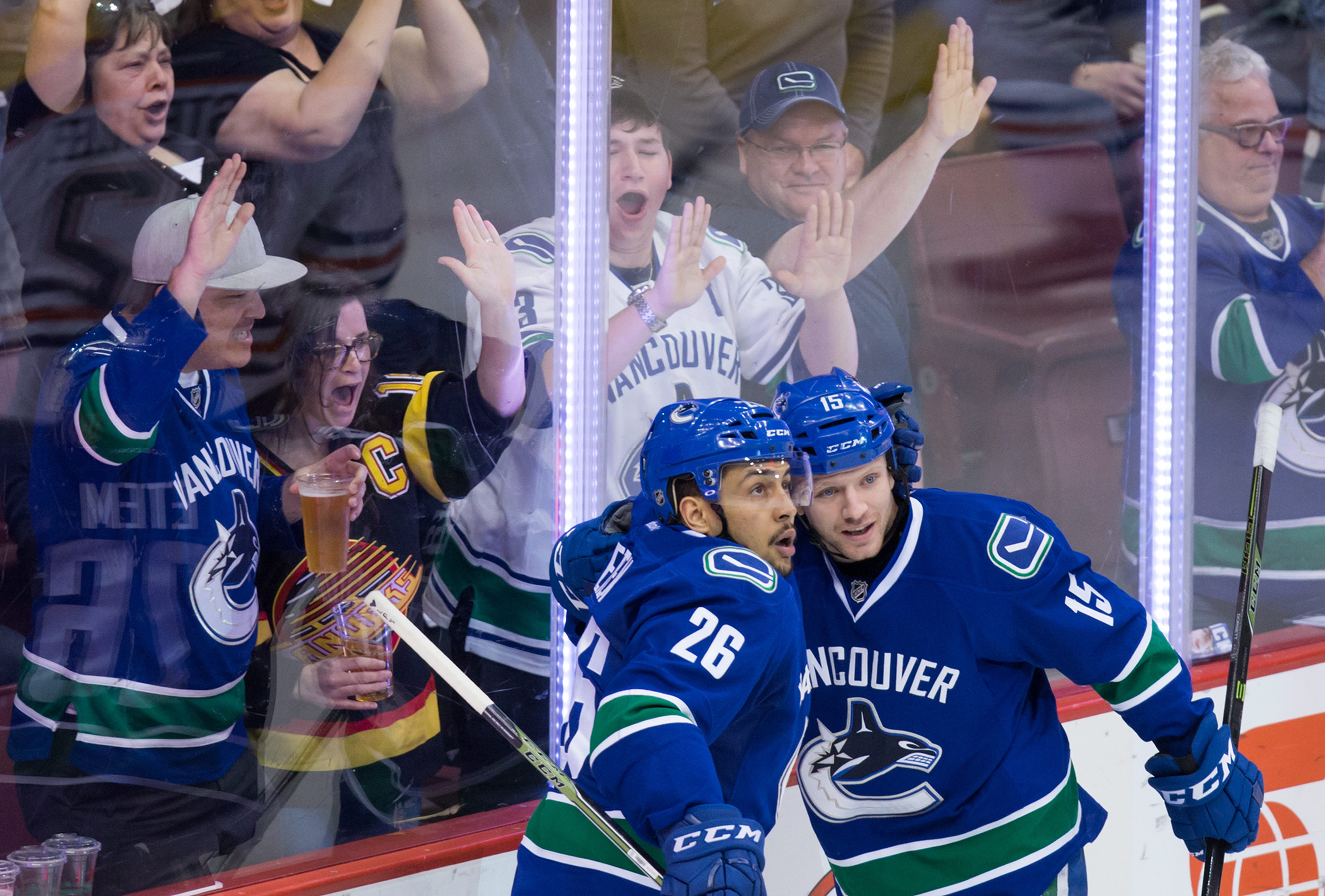 Vancouver Canucks' Emerson Etem, left, and Derek Dorsett celebrate item's goal against the Edmonton Oilers during the third period of an NHL hockey game Saturday, April 9, 2016, in Vancouver, British Columbia. (Darryl Dyck/The Canadian Press via AP)