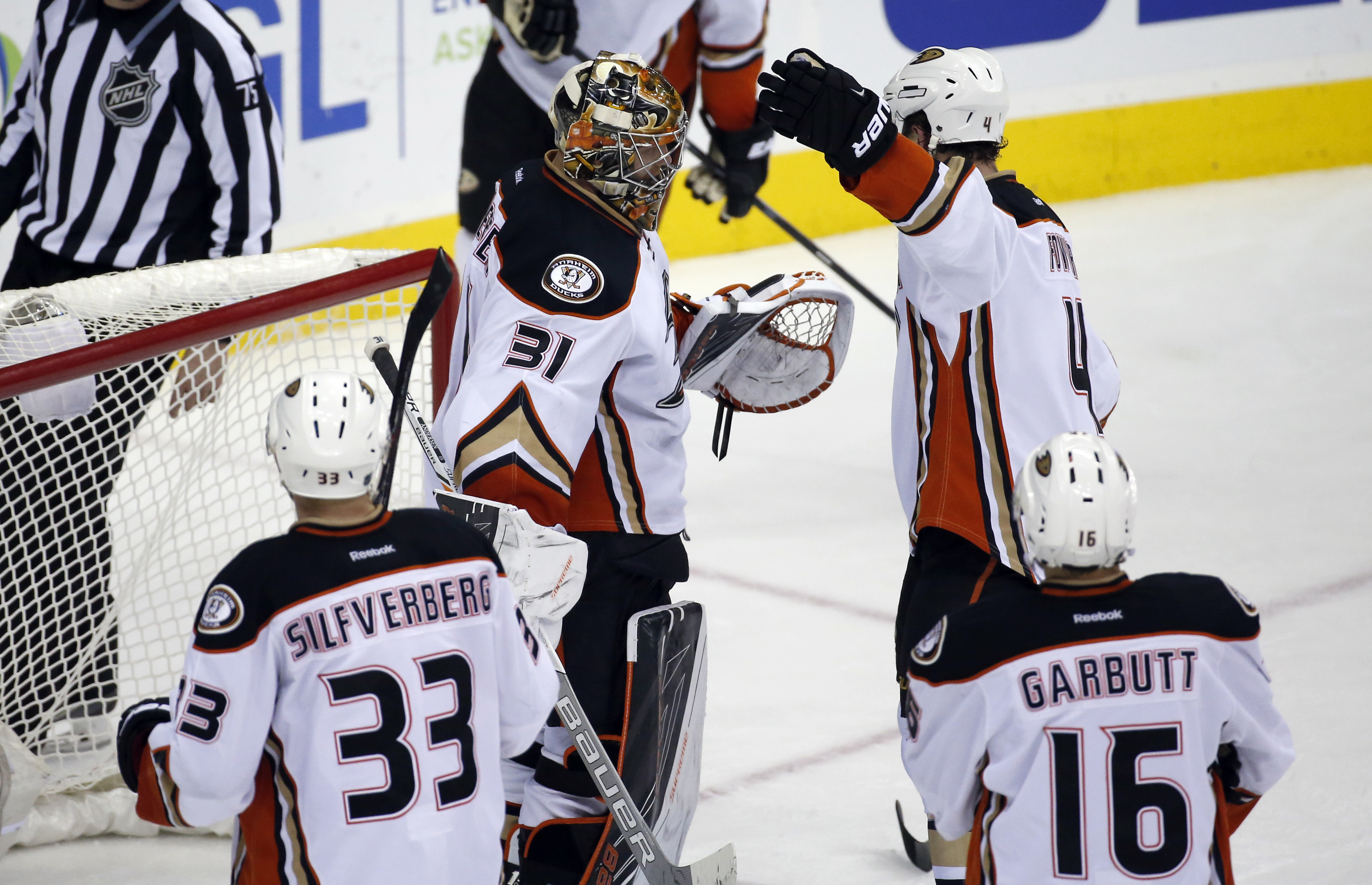 Anaheim Ducks goalie Frederik Andersen (31), from Denmark, and defenseman Cam Fowler (4), with left wing Jakob Silfverberg (33), from Sweden, and left wing Ryan Garbutt (16) celebrate after an NHL hockey game against the Washington Capitals, Sunday, April