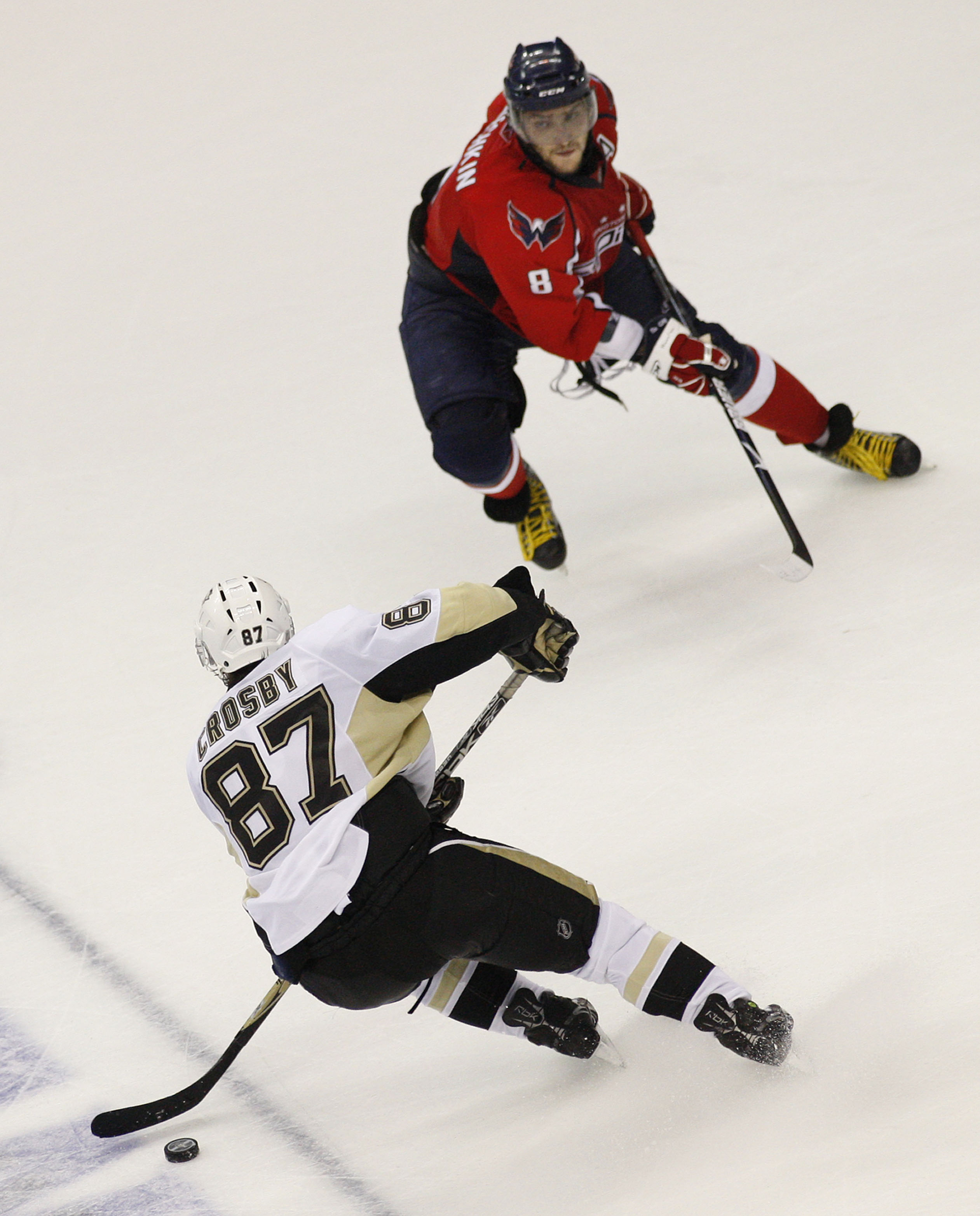 FILE - In this May 2, 2009, file photo, Pittsburgh Penguins center Sidney Crosby (87) goes up against Washington Capitals left wing Alex Ovechkin (8) from Russia during the third period of Game 1 of an NHL hockey second-round playoff series in Washington.