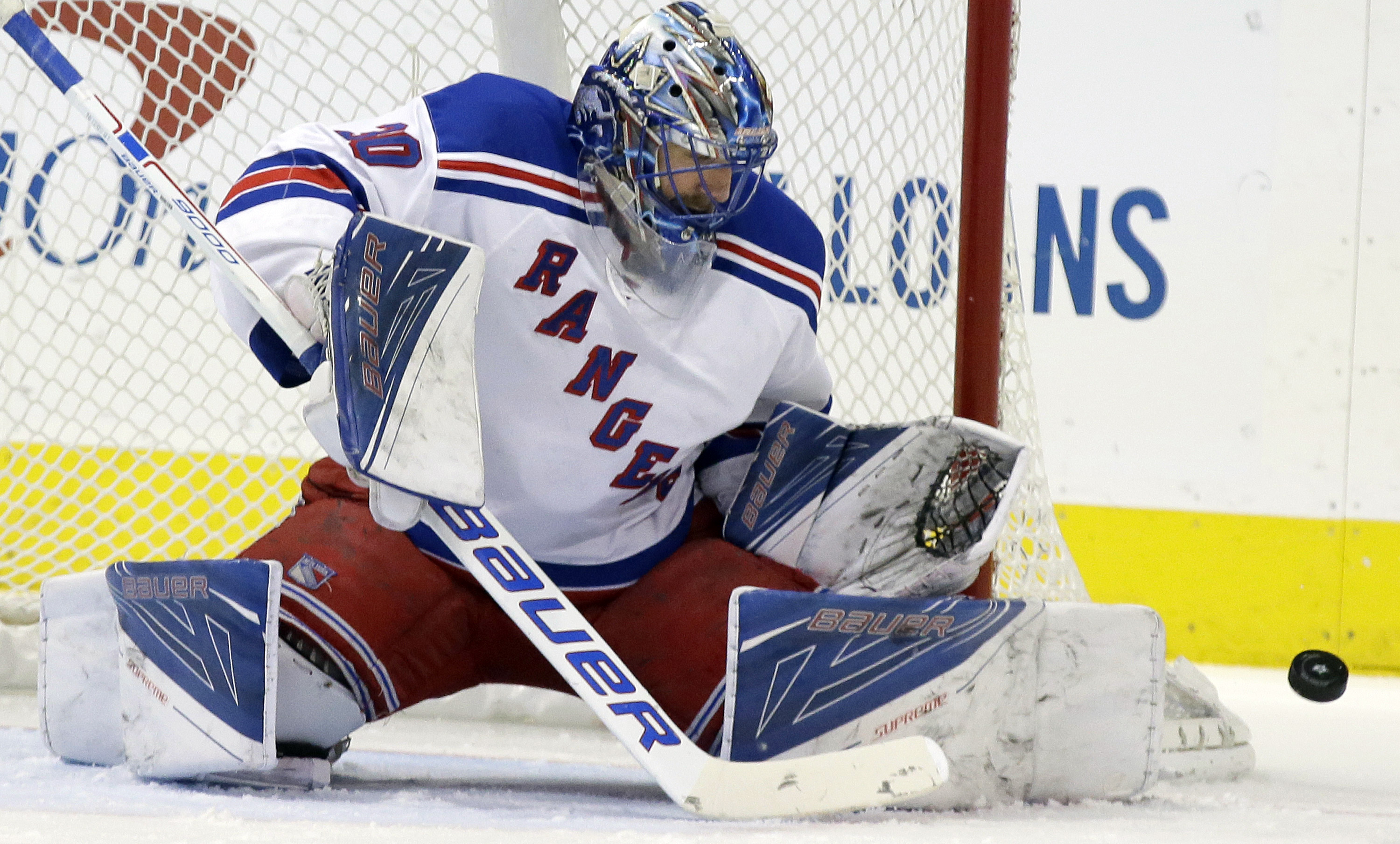 FILE - In this Feb. 27, 2016, file photo, New York Rangers goalie Henrik Lundqvist (30) blocks a shot on goal during the first period of an NHL hockey game against the Dallas Stars in Dallas. The Rangers open the Stanley Cup playoffs on Wednesday, April 1