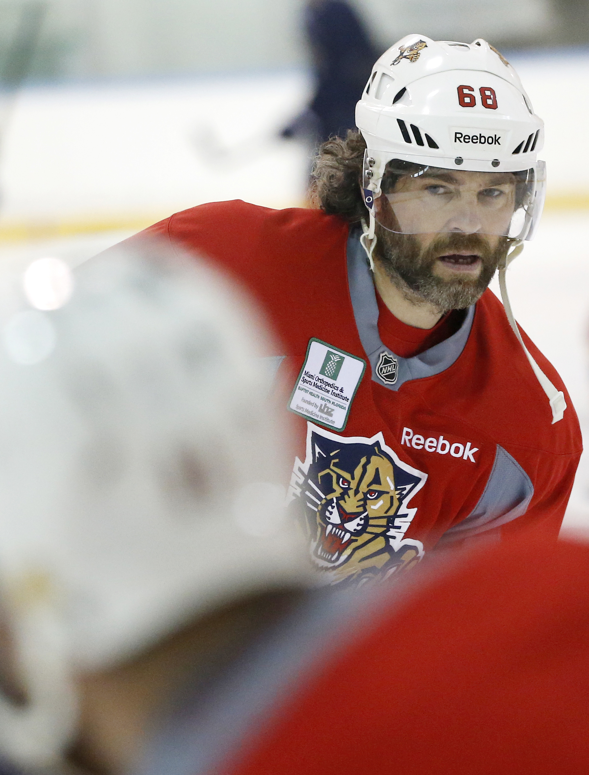 Florida Panthers right wing Jaromir Jagr prepares to pass the puck during a practice session, Tuesday, April 12, 2016, at the Panthers' practice facility in Coral Springs, Fla. The Panthers take on the New York Islanders in Game 1 of the first round of th