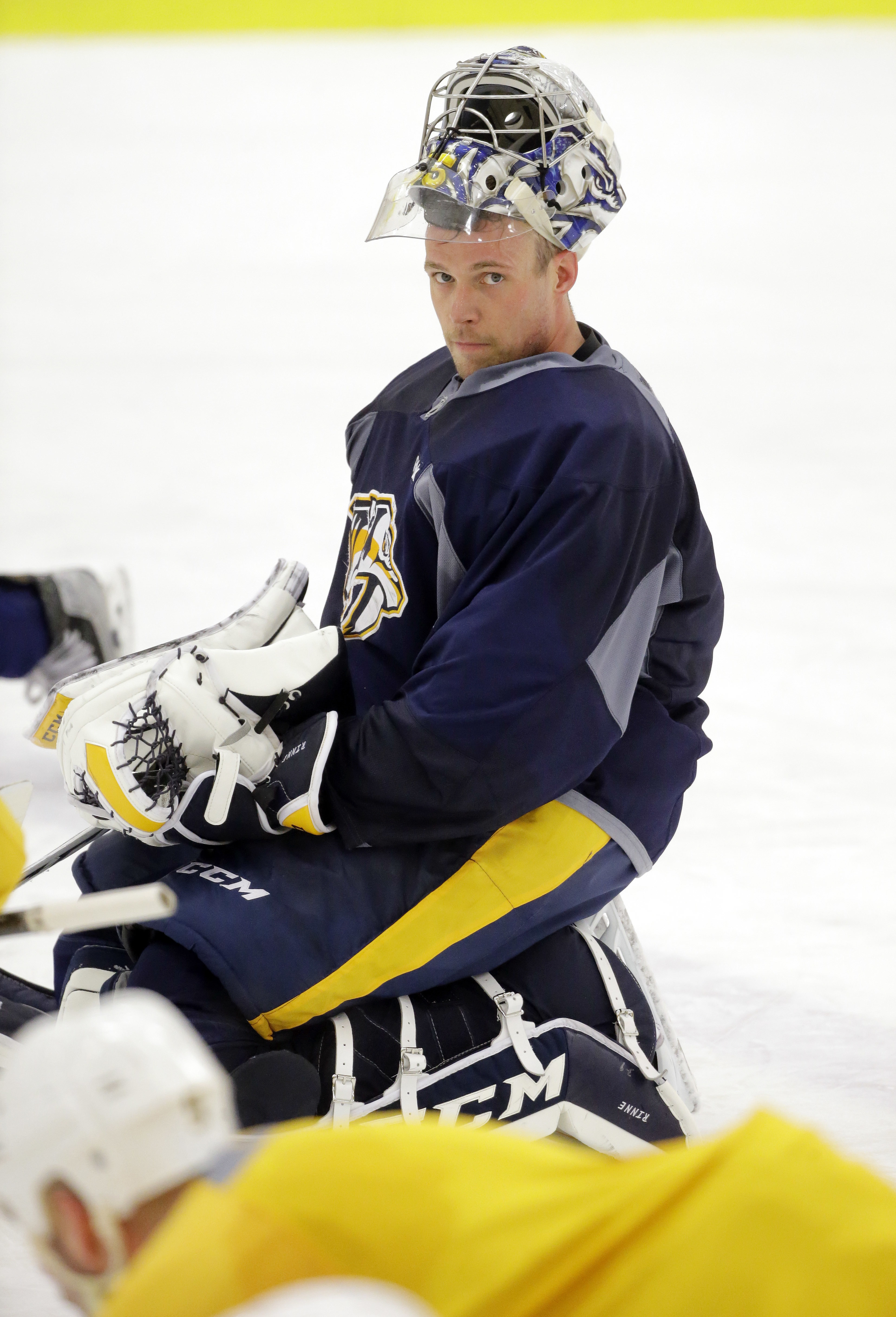 Nashville Predators goalie Pekka Rinne, of Finland, stretches during practice Tuesday, April 12, 2016, in Nashville, Tenn. The Predators are scheduled to play the Anaheim Ducks in the first round of the NHL Western Conference hockey playoffs Friday. (AP P