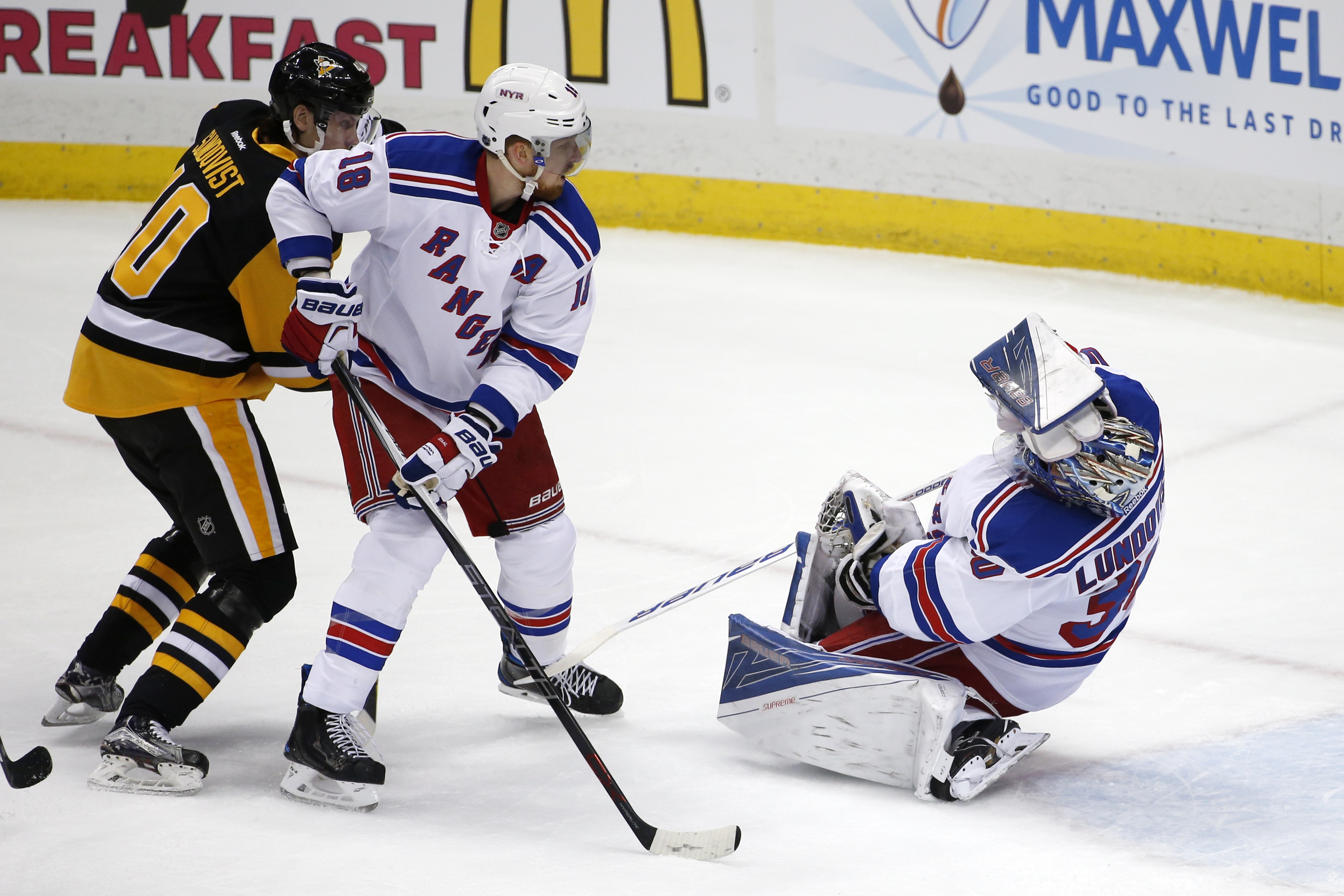 New York Rangers goalie Henrik Lundqvist (30) falls to the ice after getting a stick to the face during the first period of a first-round NHL playoff hockey game against the Pittsburgh Penguins in Pittsburgh, Wednesday, April 13, 2016. Lundqvist remained