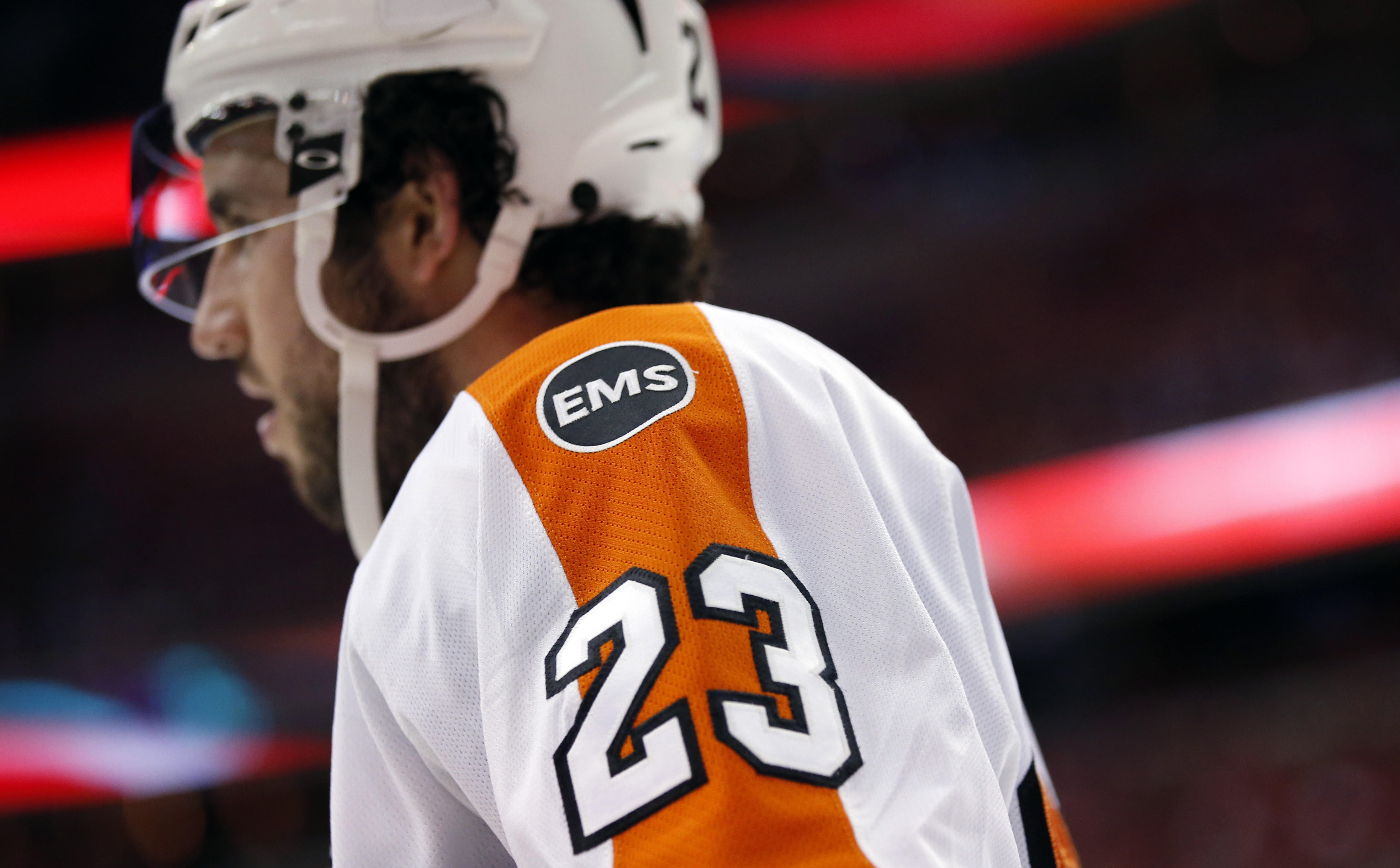 Philadelphia Flyers defenseman Brandon Manning wears an EMS patch on his shoulder for Flyers chairman Ed Snider, who died Monday, during the second period of Game 1 of a first-round NHL hockey Stanley Cup playoff series against the Washington Capitals, Th