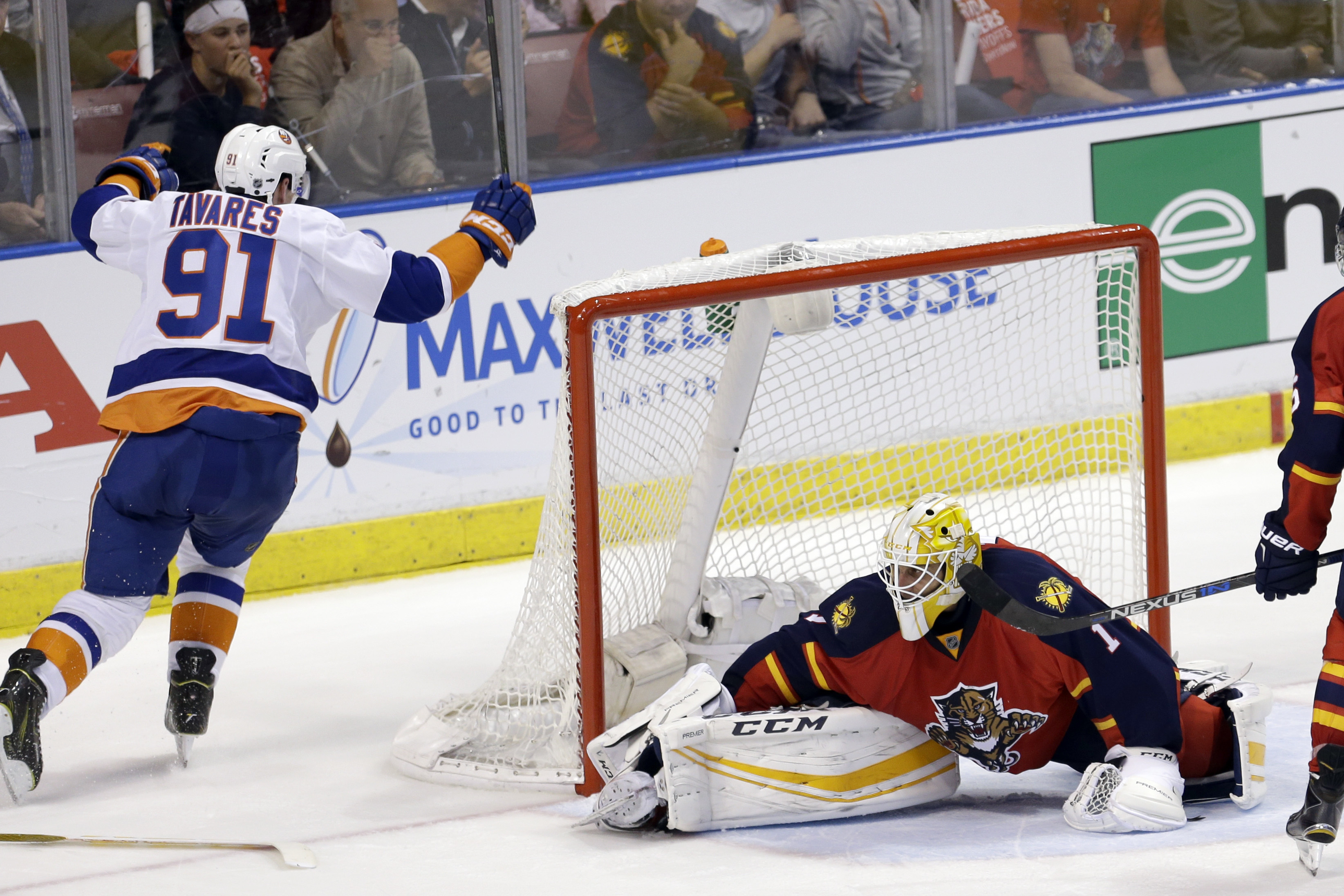 New York Islanders center John Tavares (91) celebrates after scoring a goal against Florida Panthers goalie Roberto Luongo (1) during the second period of Game 1 in a first-round NHL hockey Stanley Cup playoff series, Thursday, April 14, 2016, in Sunrise,