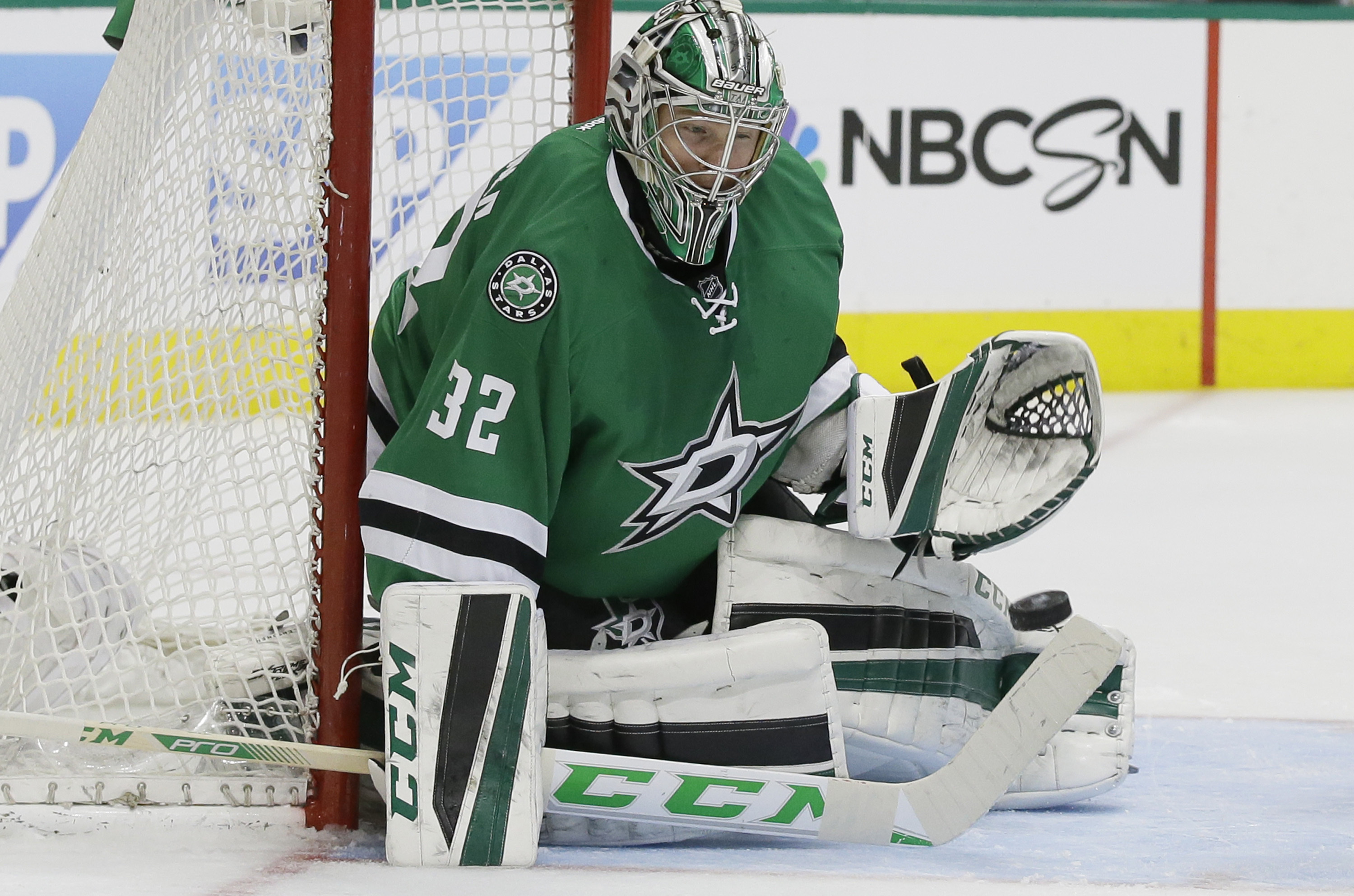 Dallas Stars goalie Kari Lehtonen (32) blocks a shot during the second period of Game 1 in a first-round NHL hockey Stanley Cup playoff series against the Minnesota Wild on Thursday, April 14, 2016, in Dallas. (AP Photo/LM Otero)