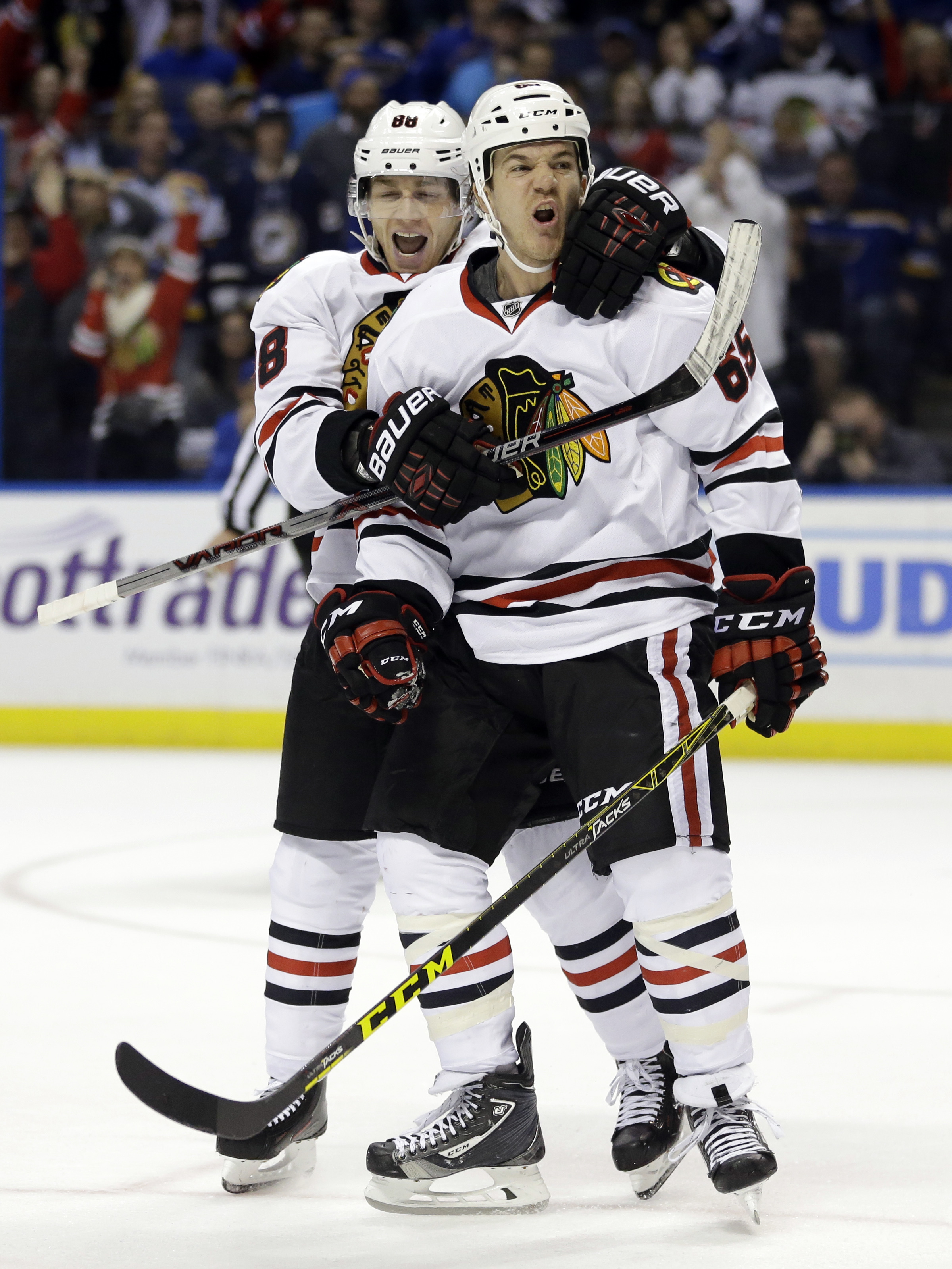 Chicago Blackhawks' Andrew Shaw, right, is congratulated by teammate Patrick Kane after scoring during the third period in Game 2 of an NHL hockey first-round Stanley Cup playoff series against the St. Louis Blues Friday, April 15, 2016, in St. Louis. (AP