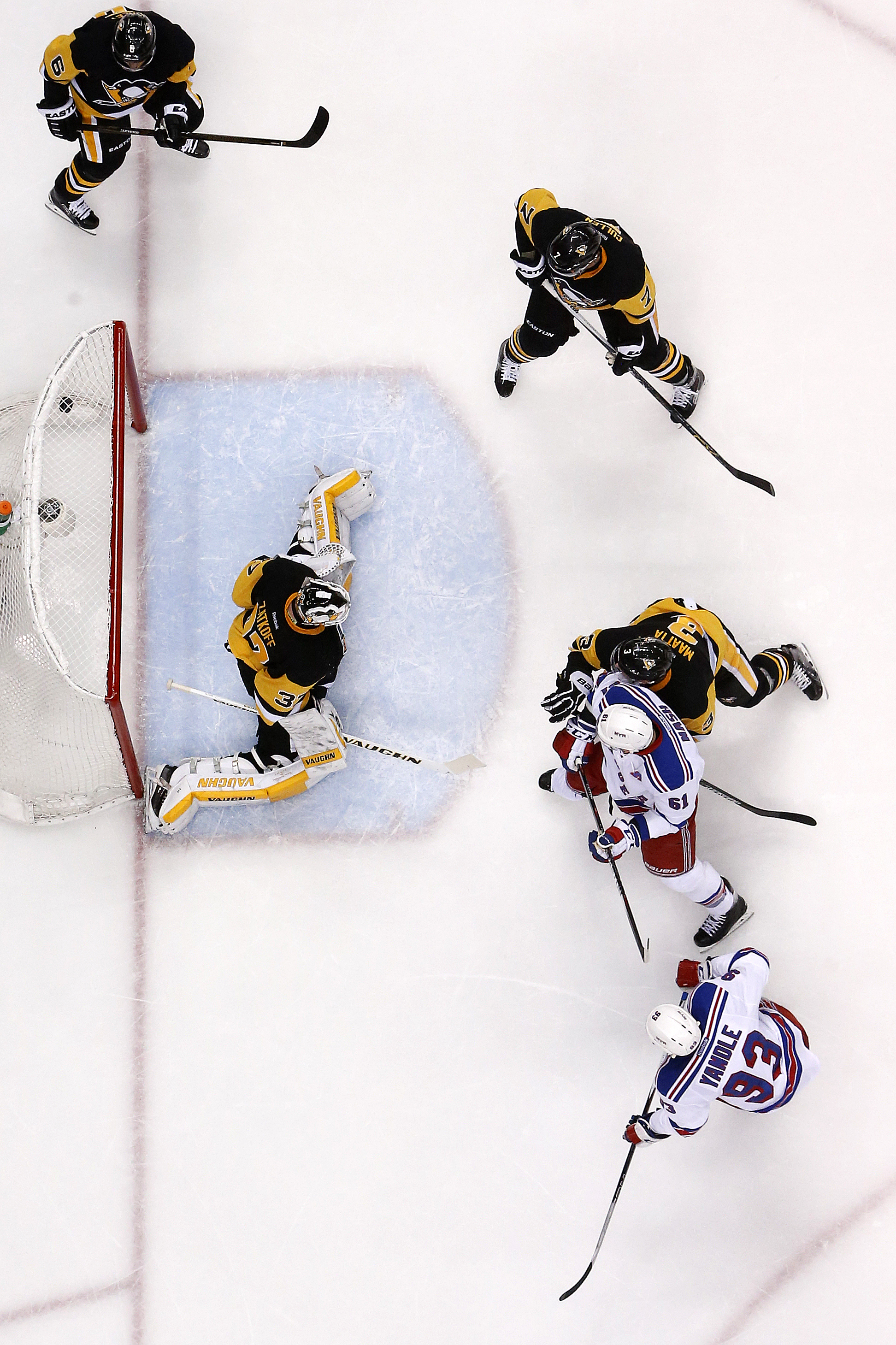 New York Rangers' Keith Yandle (93) puts the puck past Pittsburgh Penguins goalie Jeff Zatkoff (37) for a goal during the second period of Game 2 in the first round of the NHL Stanley Cup playoffs in Pittsburgh, Saturday, April 16, 2016. The Rangers won 4