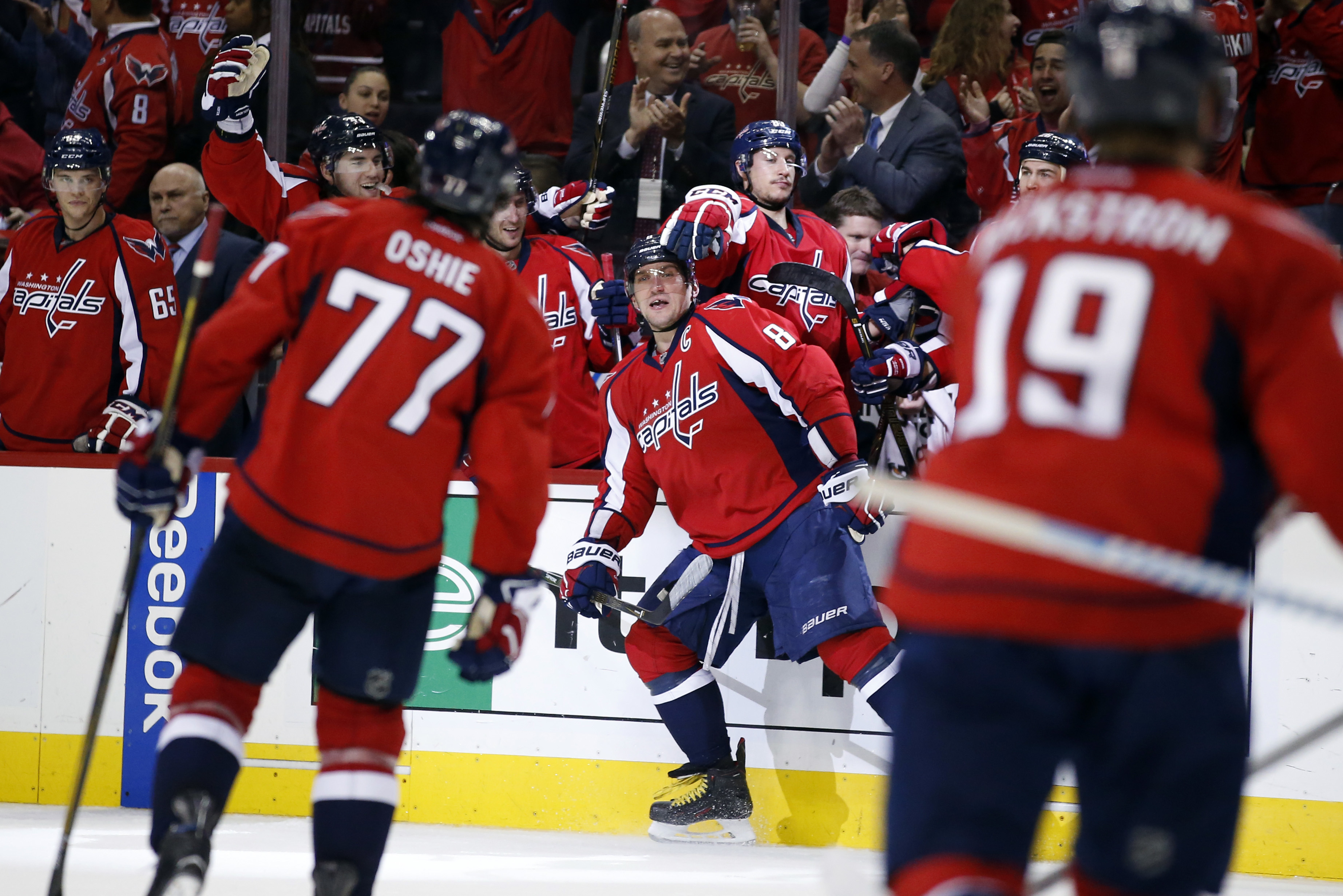 Washington Capitals left wing Alex Ovechkin (8), from Russia, celebrates his goal during the second period of Game 1 in the first round of the NHL Stanley Cup hockey playoffs against the Philadelphia Flyers, Saturday, April 16, 2016, in Washington. (AP Ph