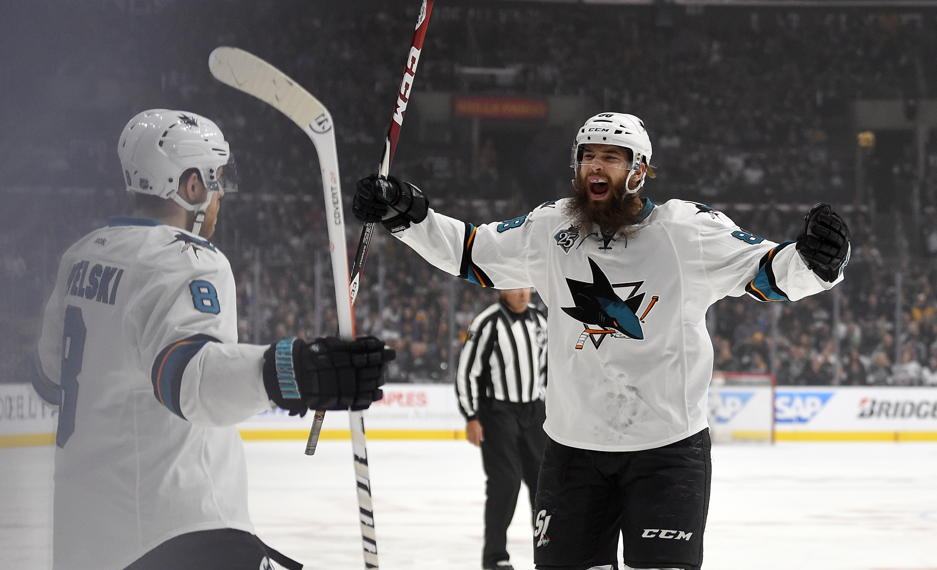 San Jose Sharks center Joe Pavelski, left, celebrates his goal with defenseman Brent Burns during the first period of Game 2 in an NHL hockey Stanley Cup playoffs first-round series against the Los Angeles Kings, Saturday, April 16, 2016, in Los Angeles.