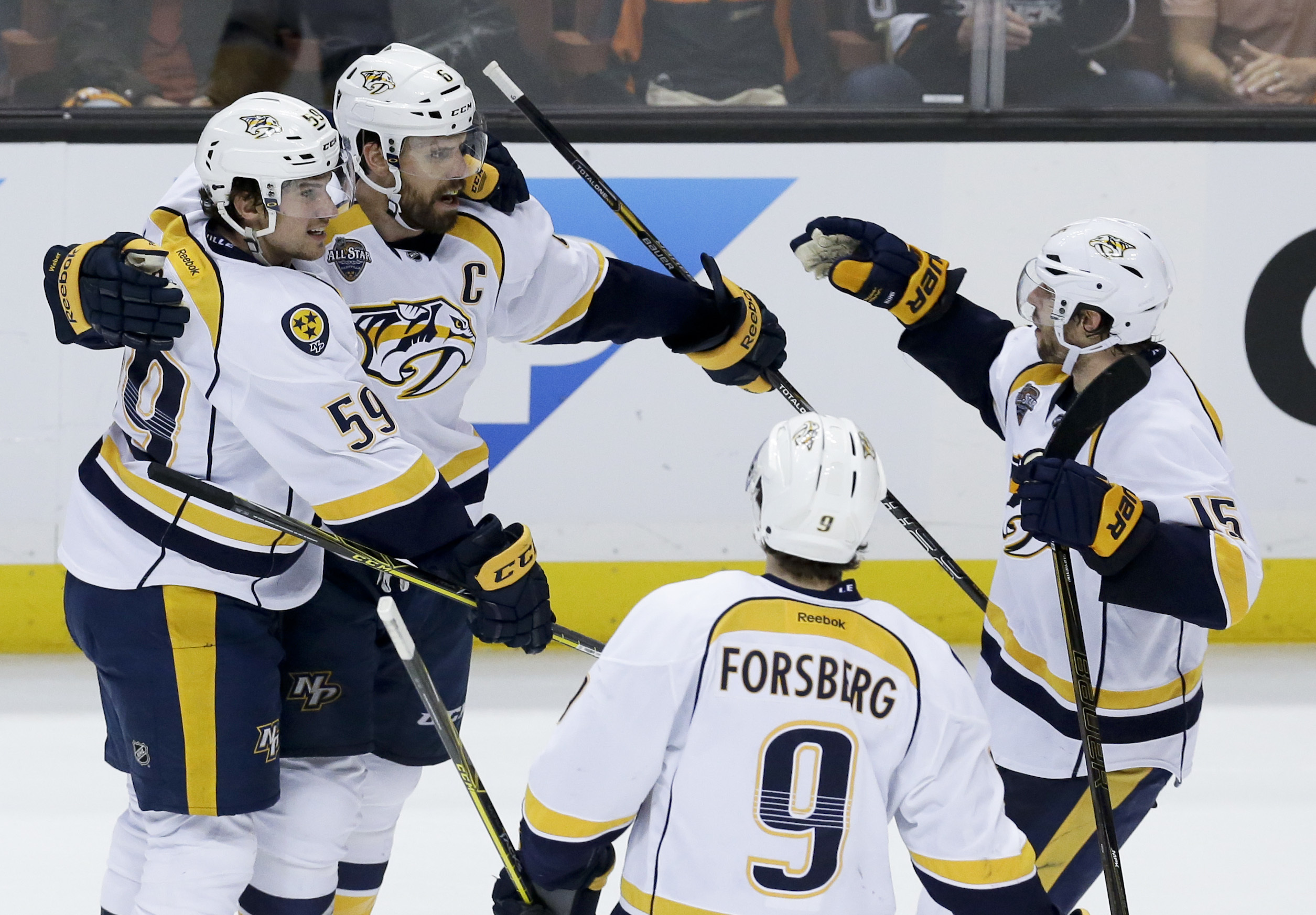 Nashville Predators defenseman Shea Weber (6) celebrates after scoring with teammates during the second period of Game 2 of an NHL hockey first-round Stanley Cup playoff series against the Anaheim Ducks in Anaheim, Calif., Sunday, April 17, 2016. (AP Phot