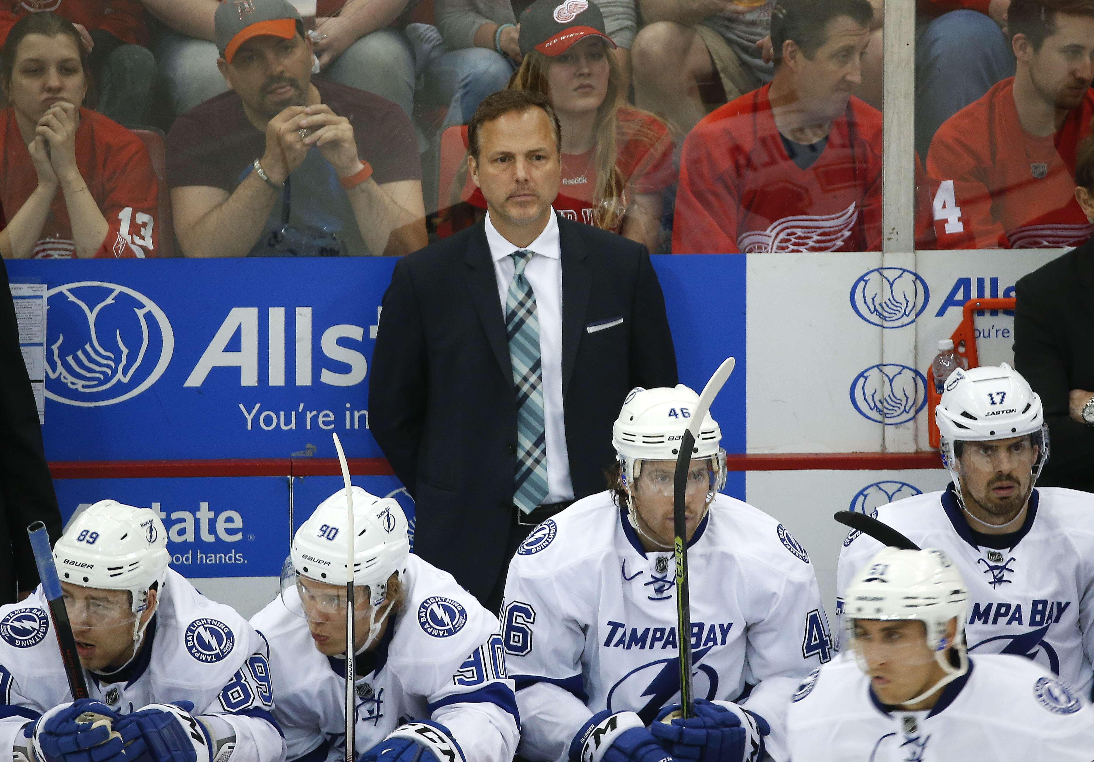 In this Sunday, April 17, 2016 photo, Tampa Bay Lightning head coach Jon Cooper watches against the Detroit Red Wings in the third period of Game 3 in a first-round NHL hockey Stanley Cup playoff series in Detroit. Cooper left Wall Street to be a lawyer,