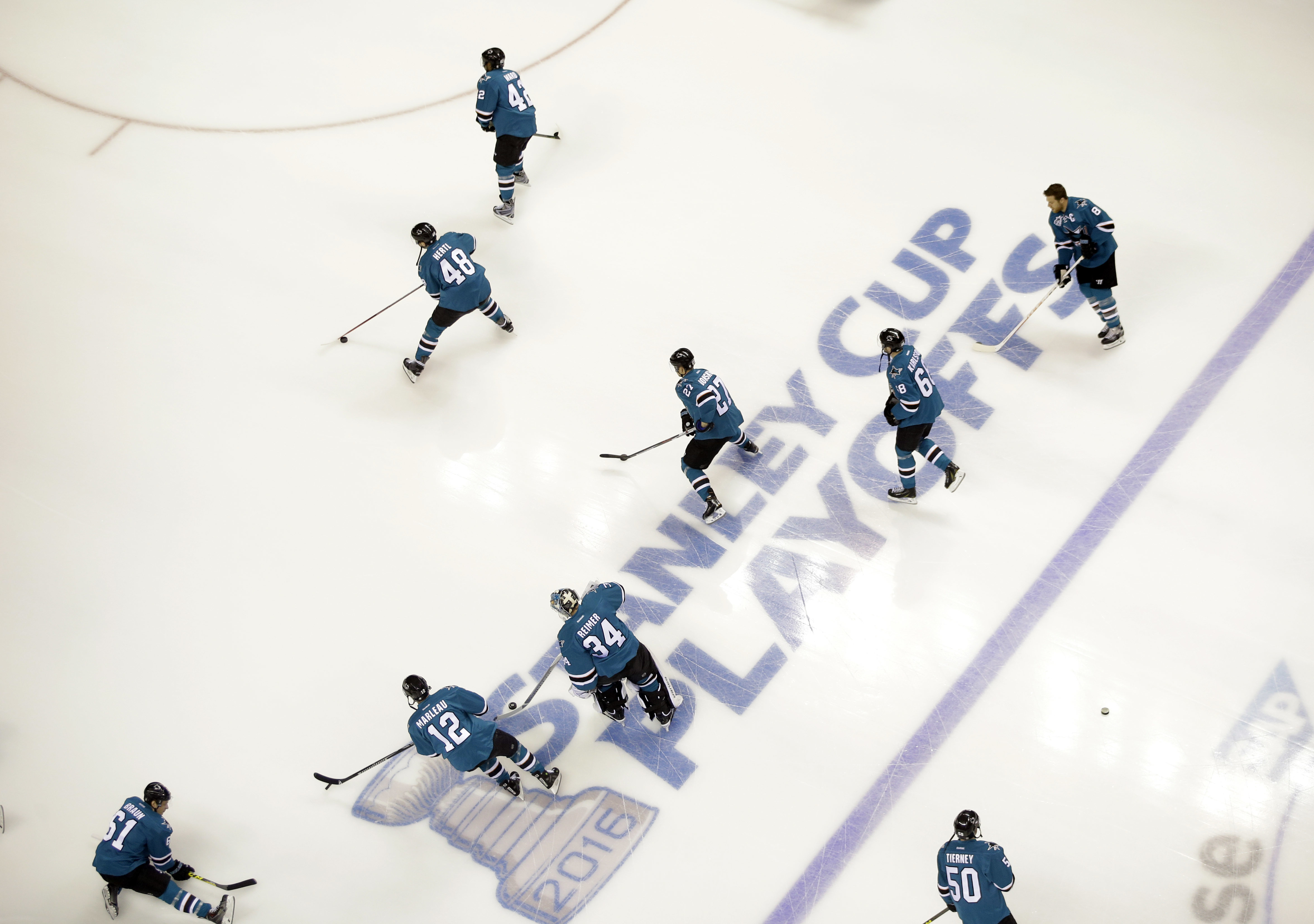 San Jose Sharks players warm up before Game 3 of an NHL hockey first-round Stanley Cup playoff series against the Los Angeles Kings Monday, April 18, 2016, in San Jose, Calif. (AP Photo/Marcio Jose Sanchez)