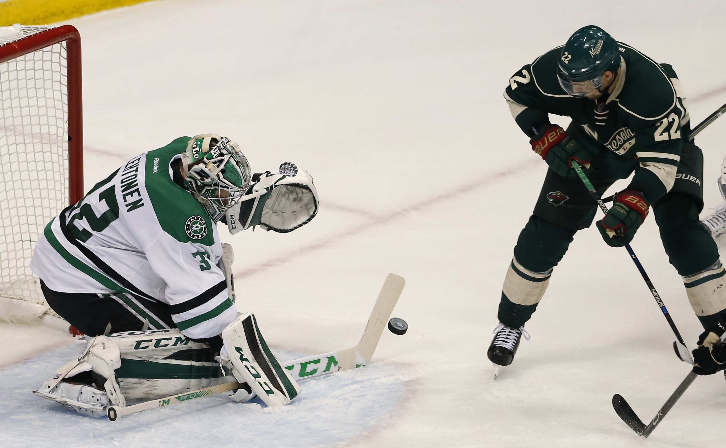 Dallas Stars goalie Kari Lehtonen (32) deflects a shot by Minnesota Wild right wing Nino Niederreiter (22) during the second period of Game 3 in the first round of the NHL Stanley Cup playoffs in St. Paul, Minn., Monday, April 18, 2016. (AP Photo/Ann Heis