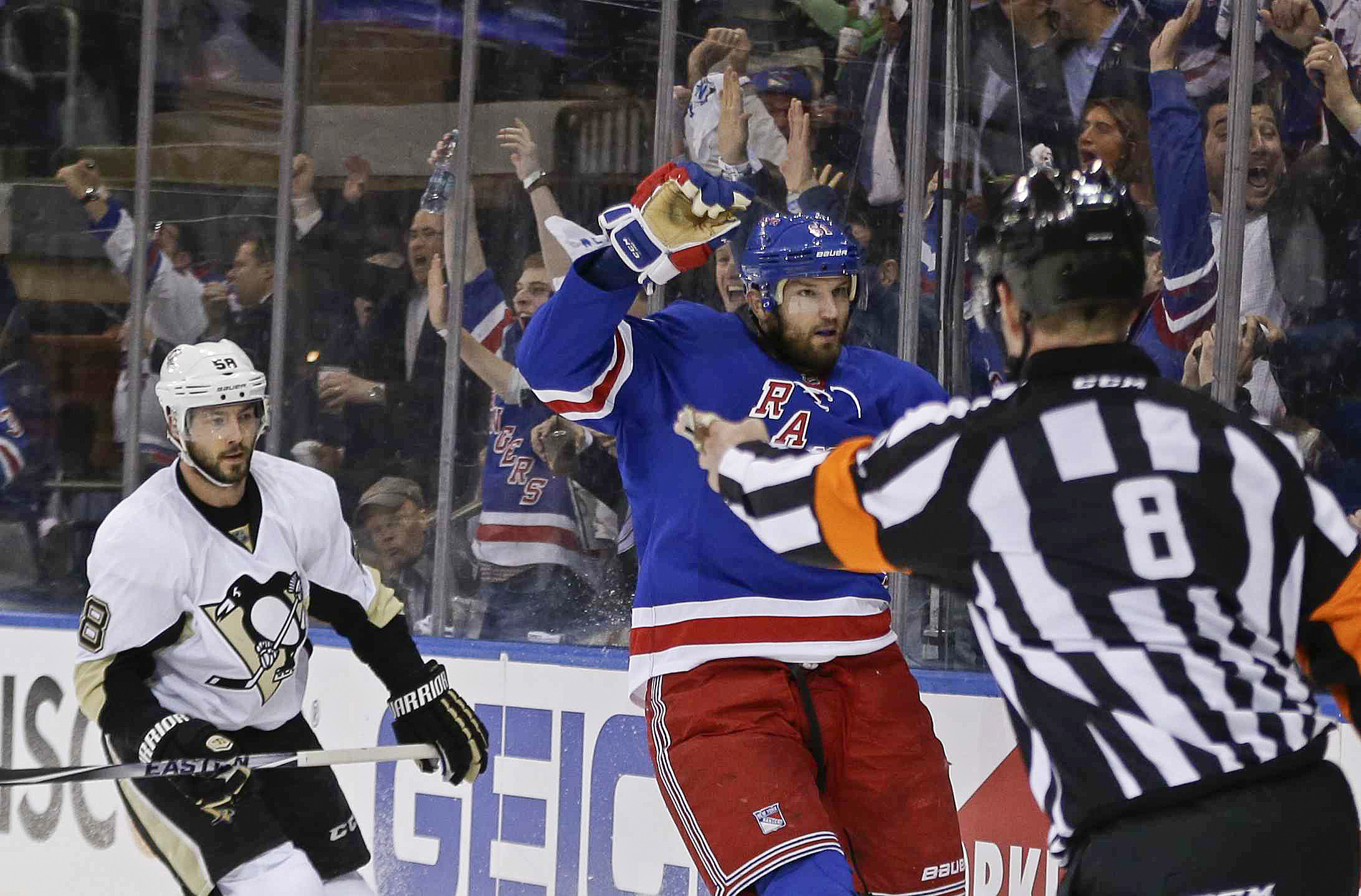New York Rangers' Rick Nash celebrates after scoring a goal as Pittsburgh Penguins' Kris Letang (58) watches during the second period of Game 3 of a first-round NHL playoff hockey series Tuesday, April 19, 2016, in New York. (AP Photo/Frank Franklin II)